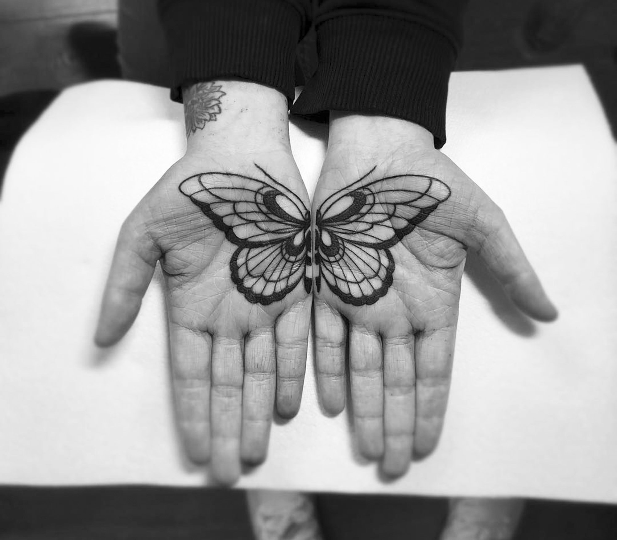 butterfly, overlay palm, hand tattooo