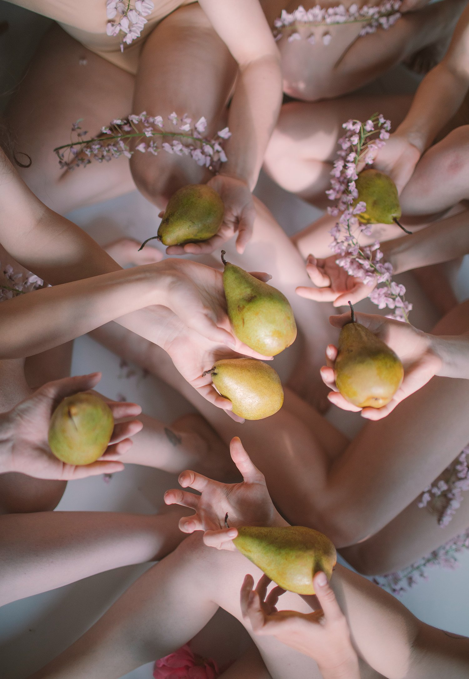 holding pears, photography