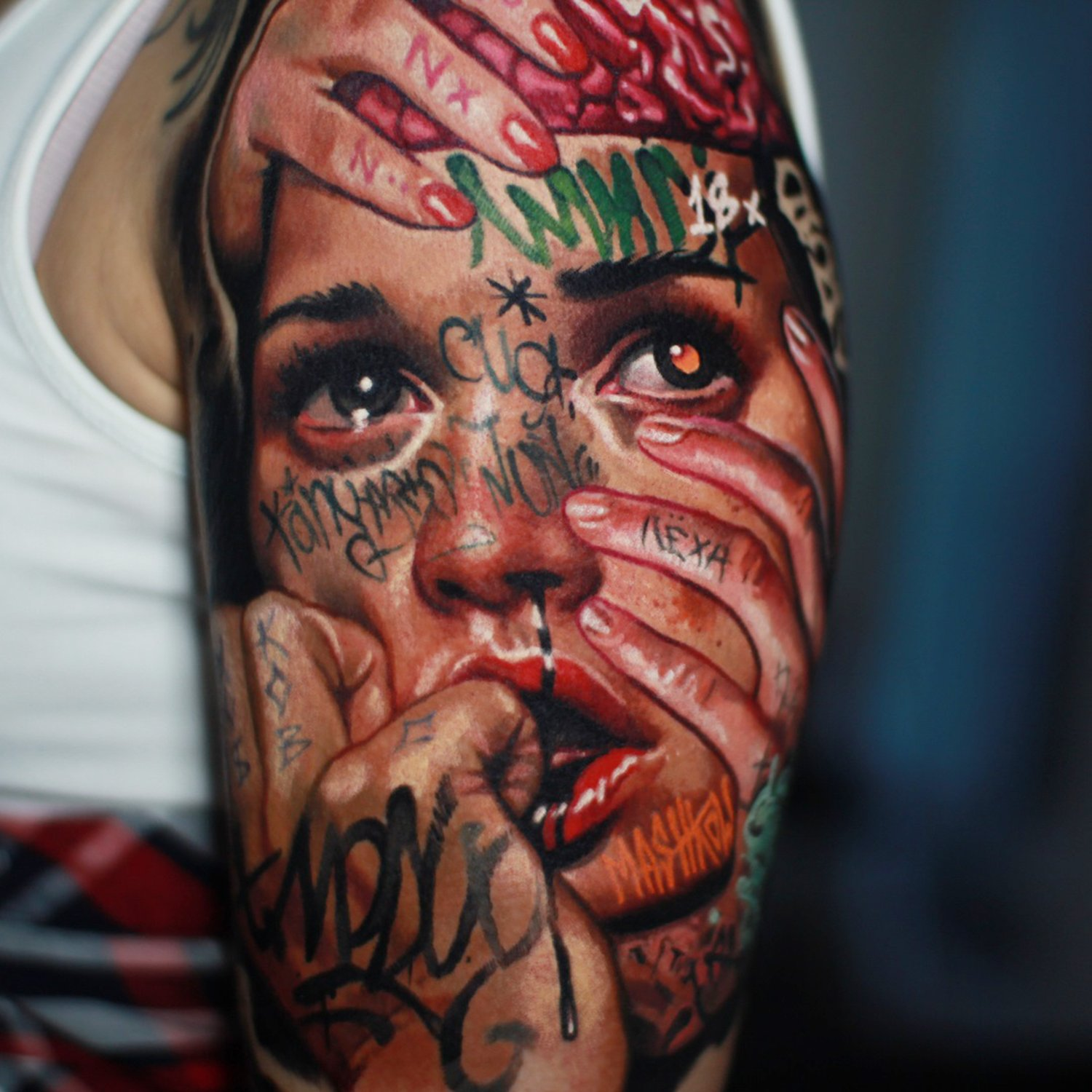 closeup of tattoo, crying girl with graf face