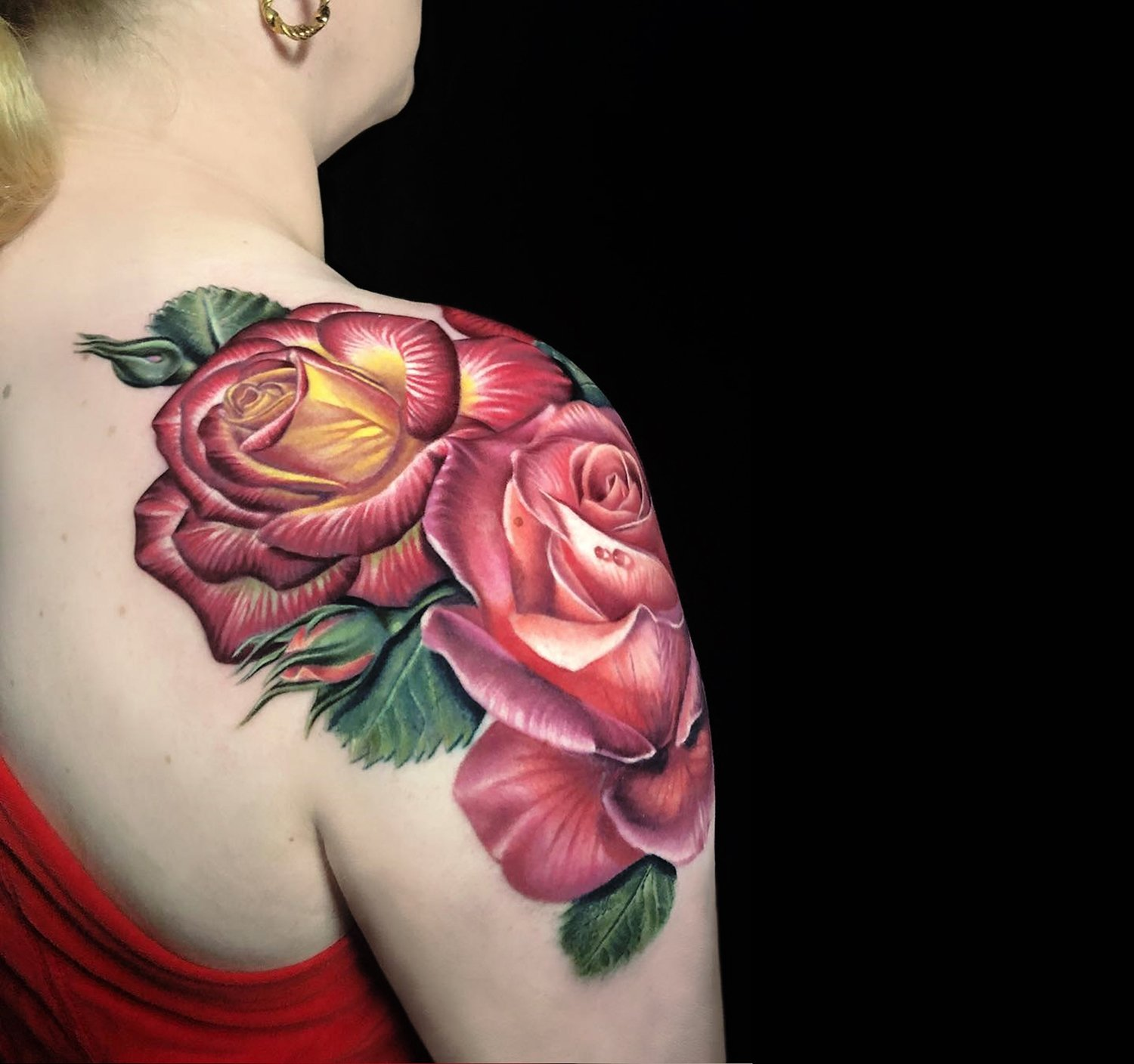 rose tattoo on shoulder by megan massacre