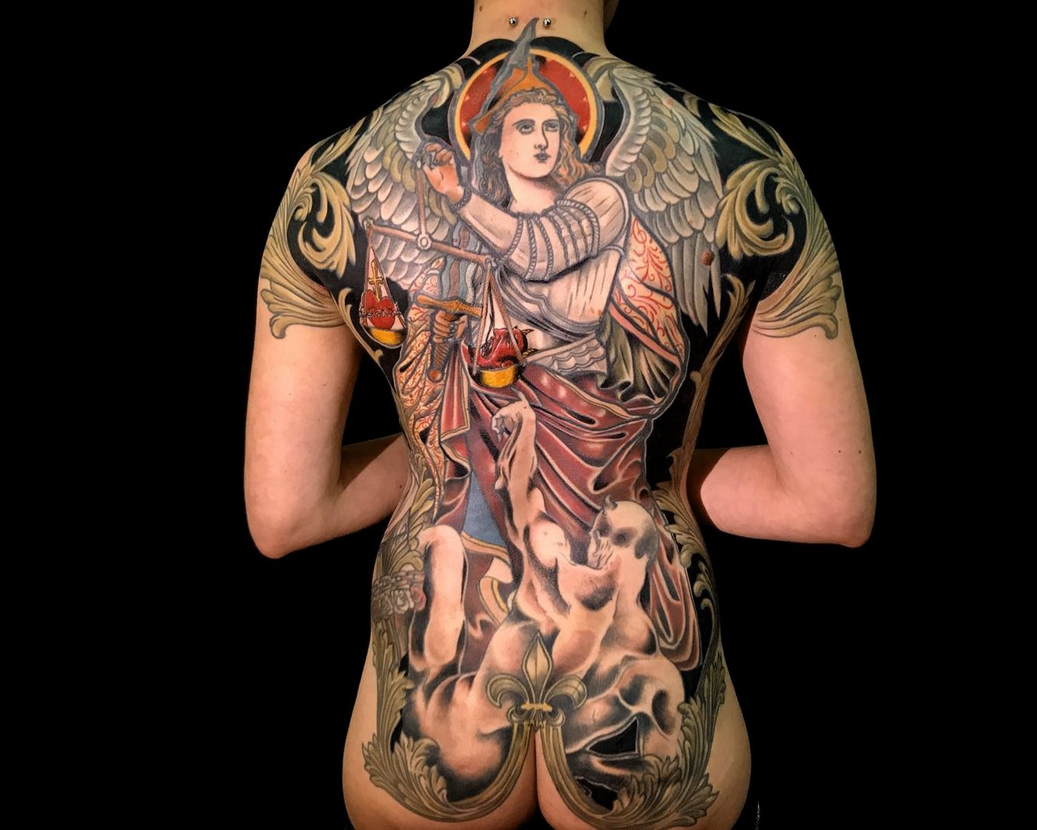 medieval tattoo on back