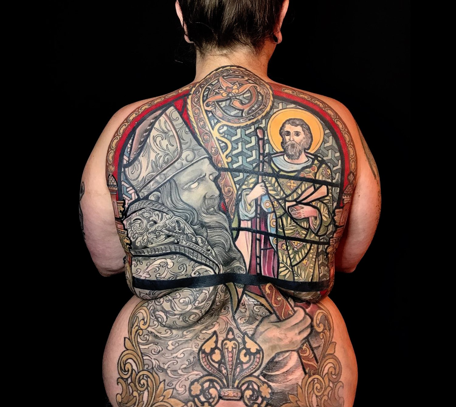 religious piece, stainless glass tattoo on back