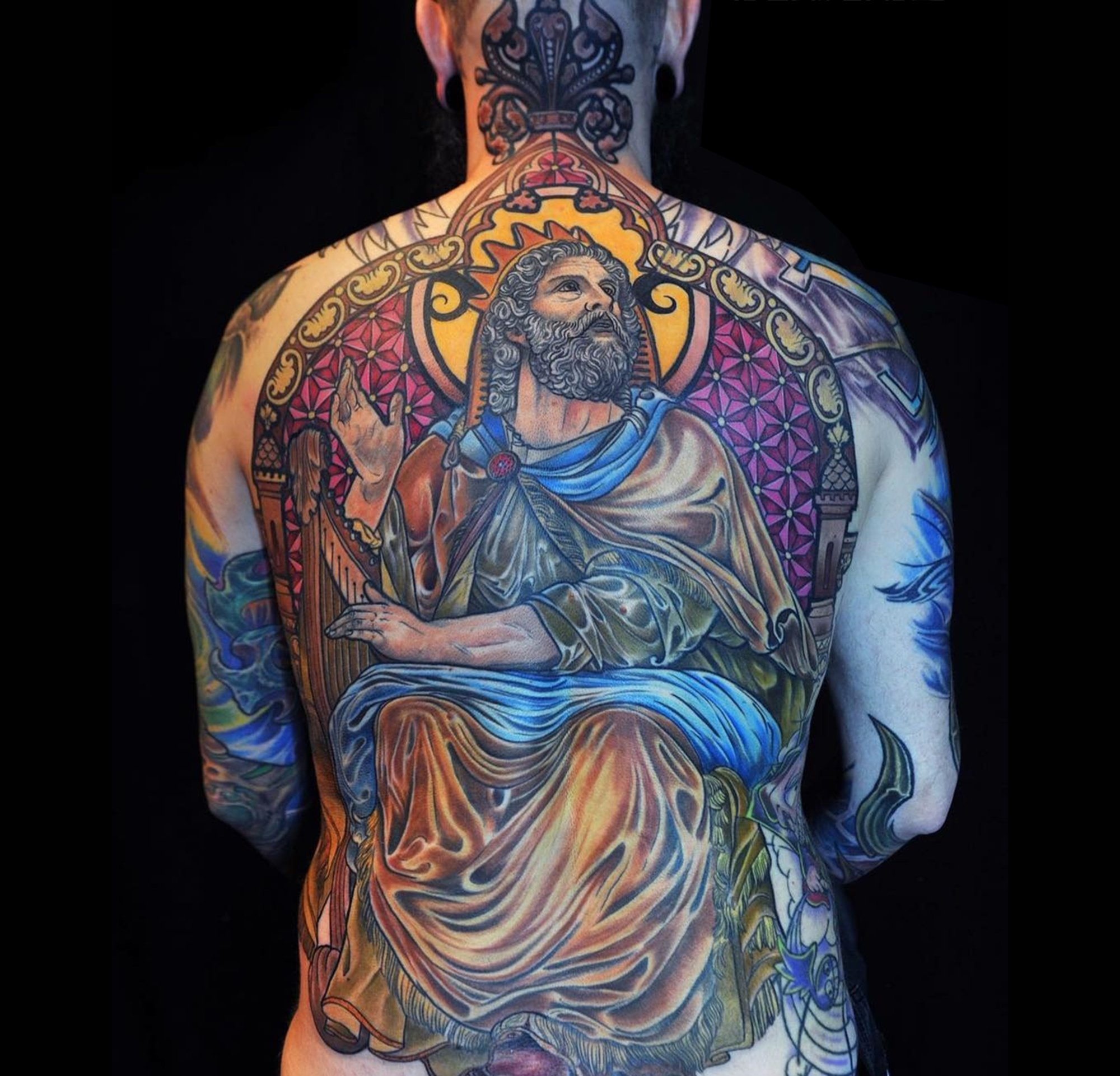 religious, medieval, stainless glass tattoo on back