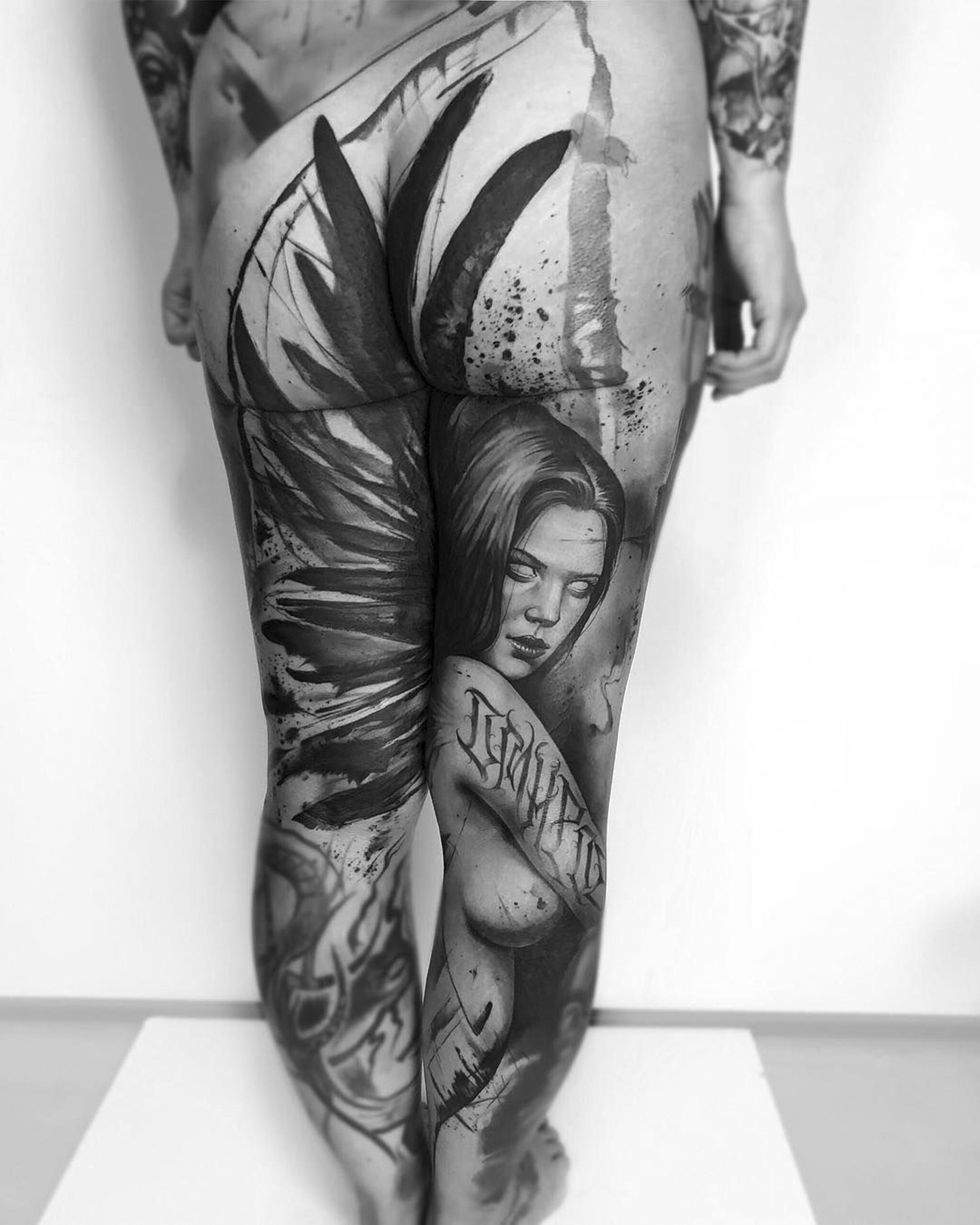 natalie nox and benjamin laukis collaborative tattoo on legs, angel tattoo