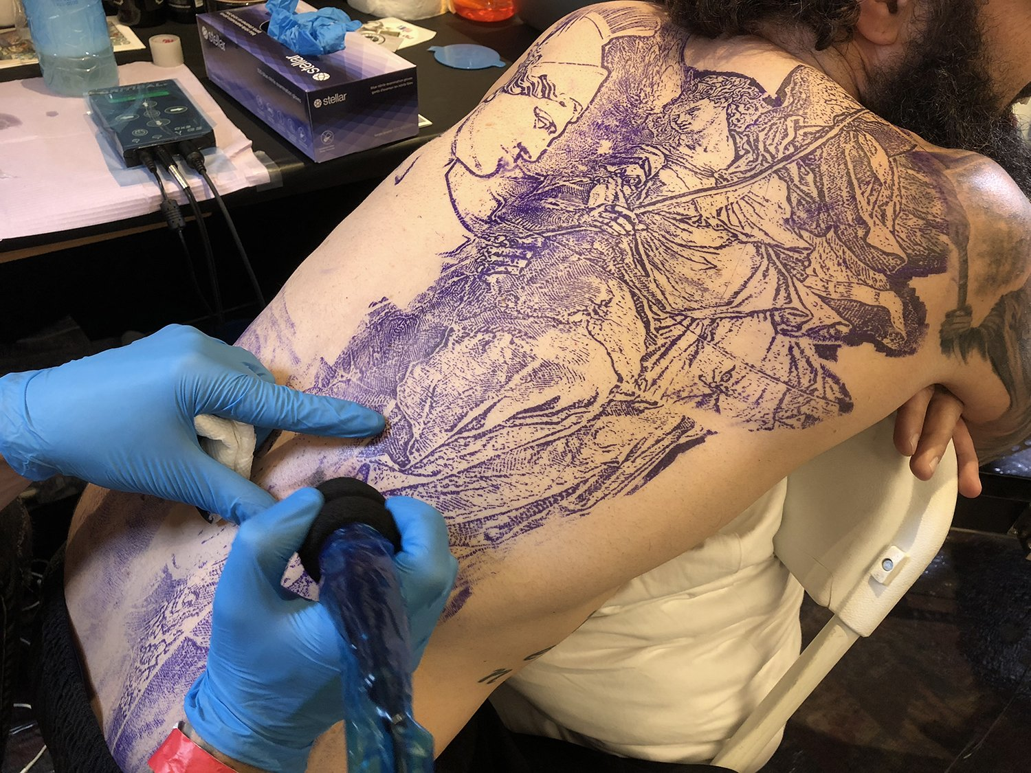 stencil on back, tattoo by marc roy