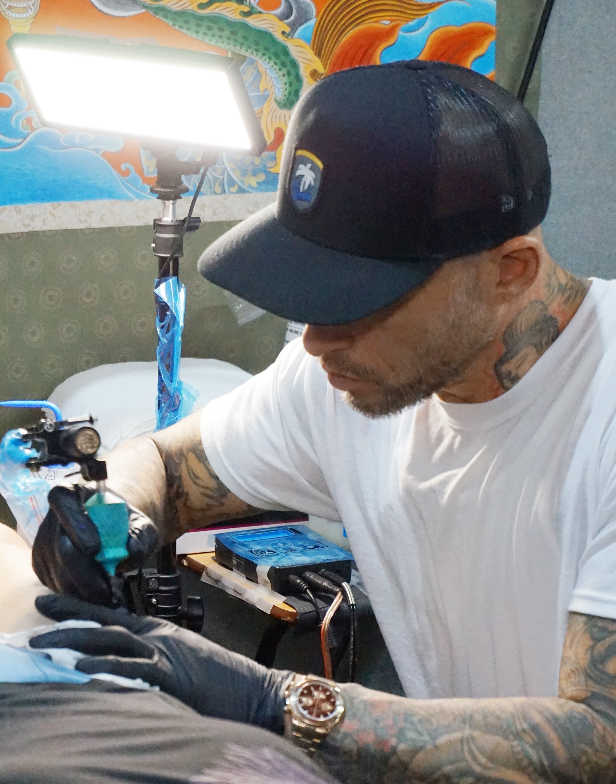 Ami James tattooing at london tattoo convention