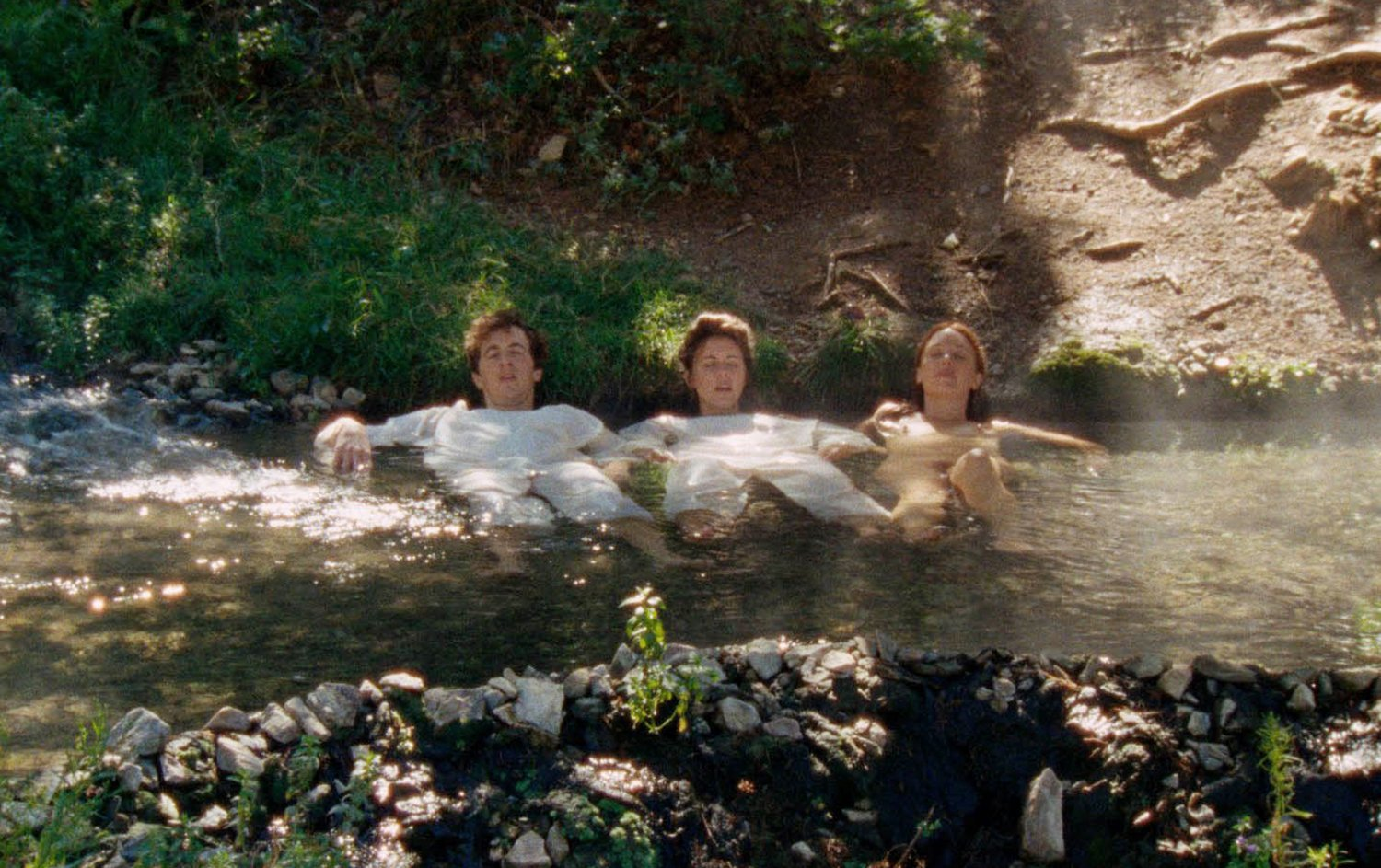 three people laying in water, Two Plains and a Fancy
