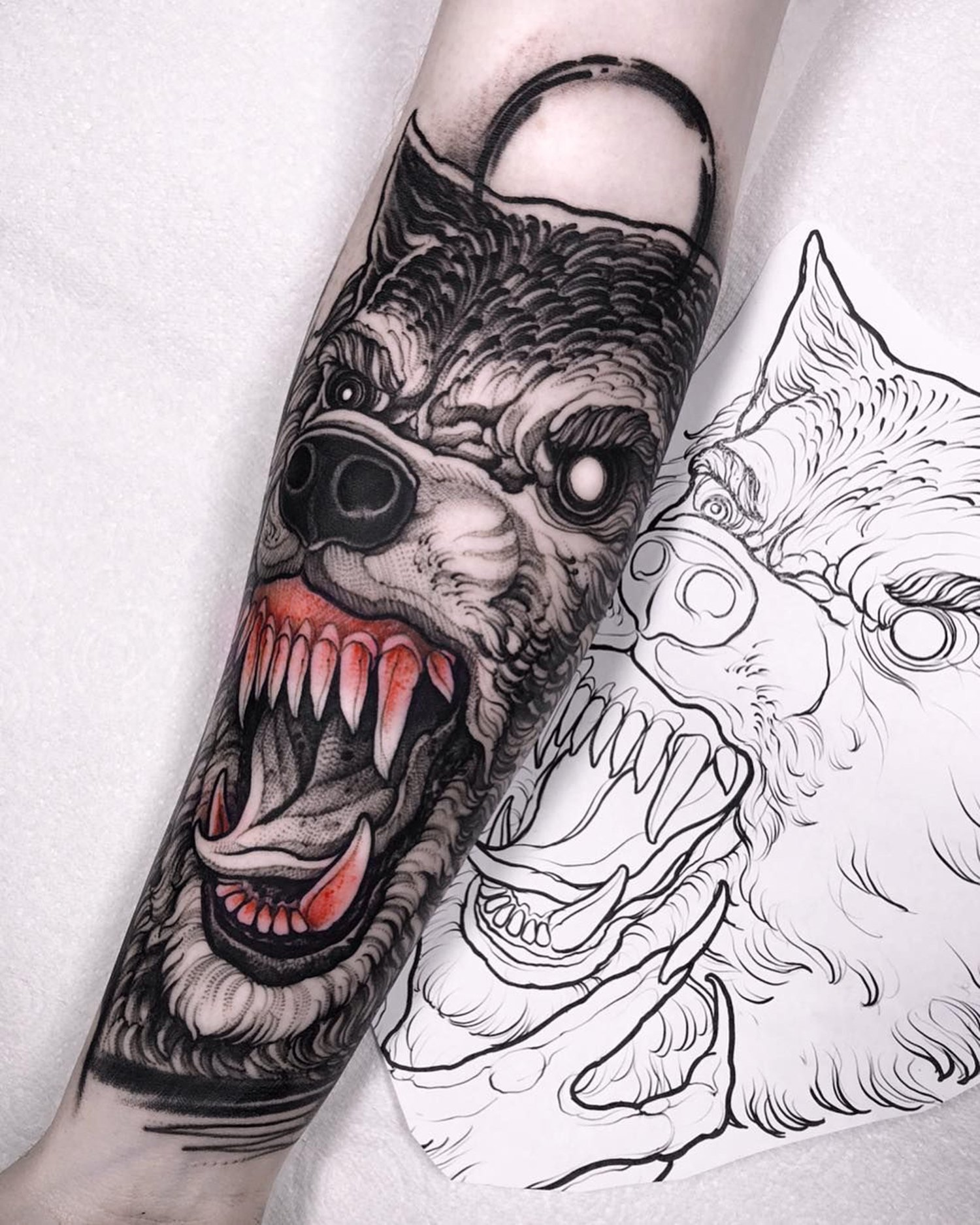 wolf, black and red tattoo
