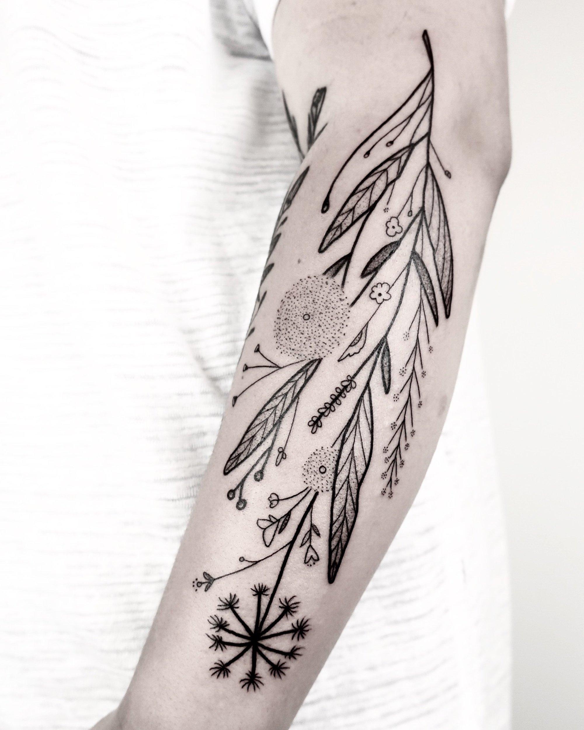 floral blackwork tattoo on arm