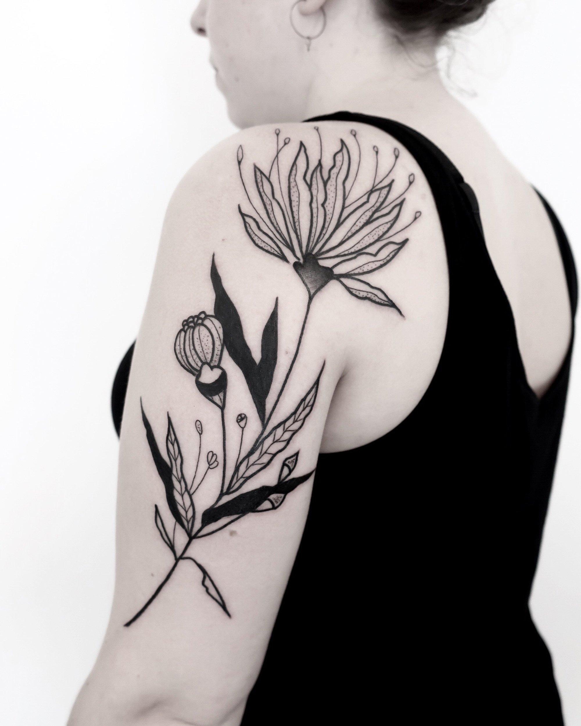 shoulder and arm, blackwork, floral tattoo