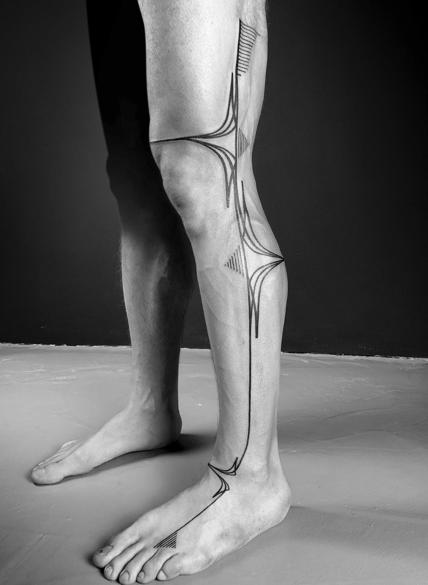 blackwork tattoo on leg