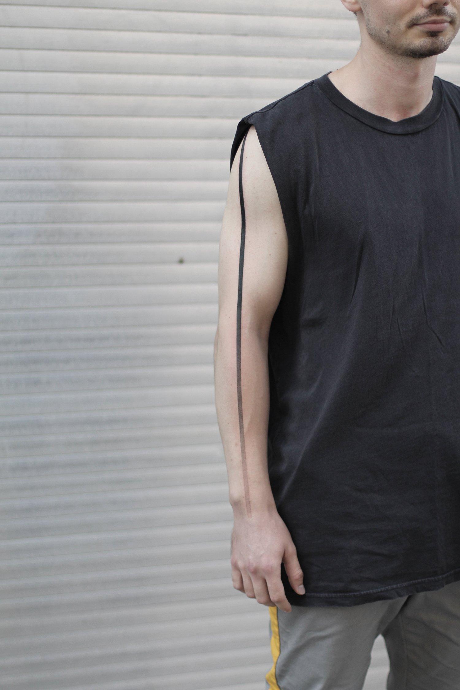 linework, line tattoo on arm, minimalist