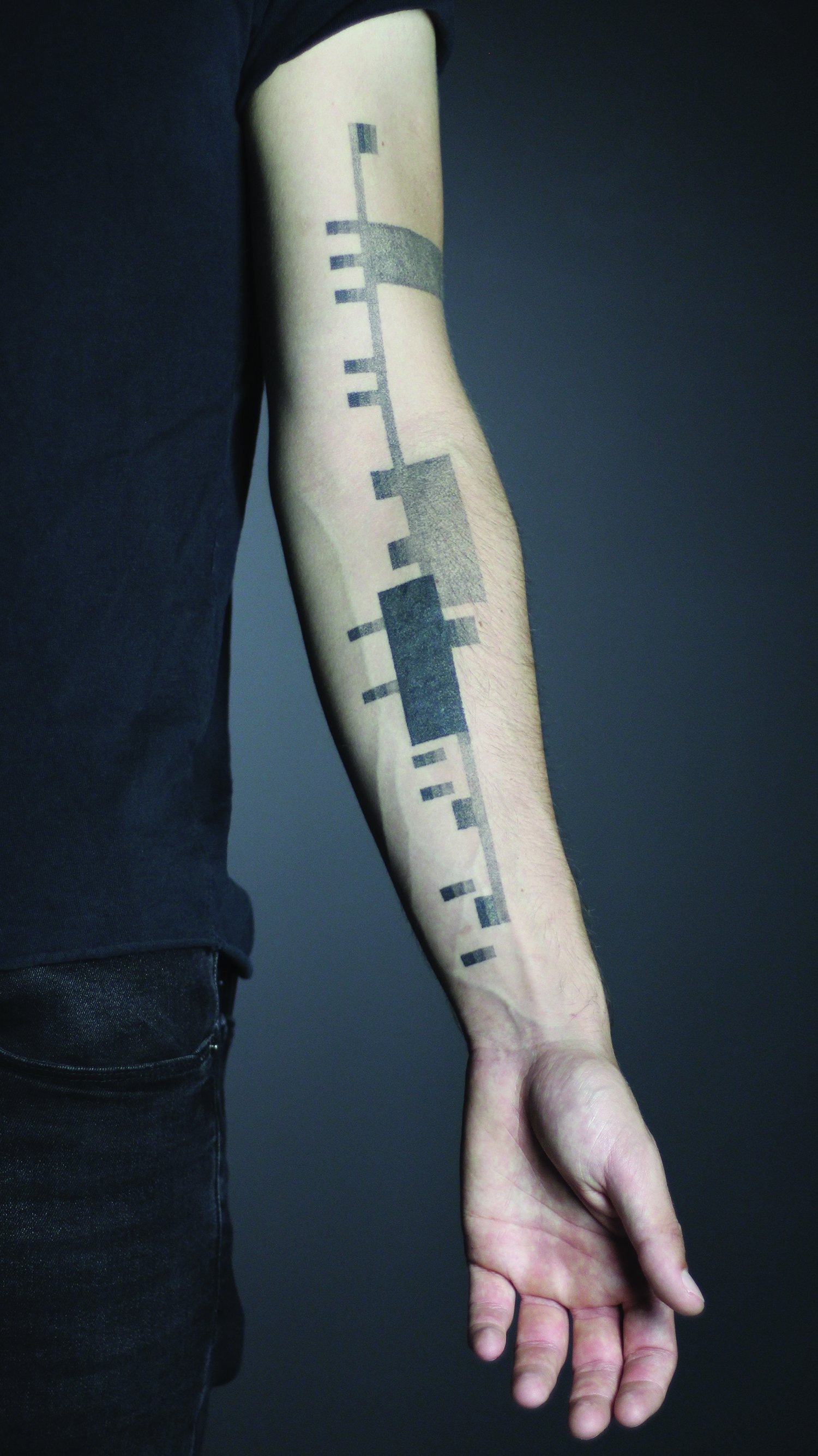 geometric tattoo on arm