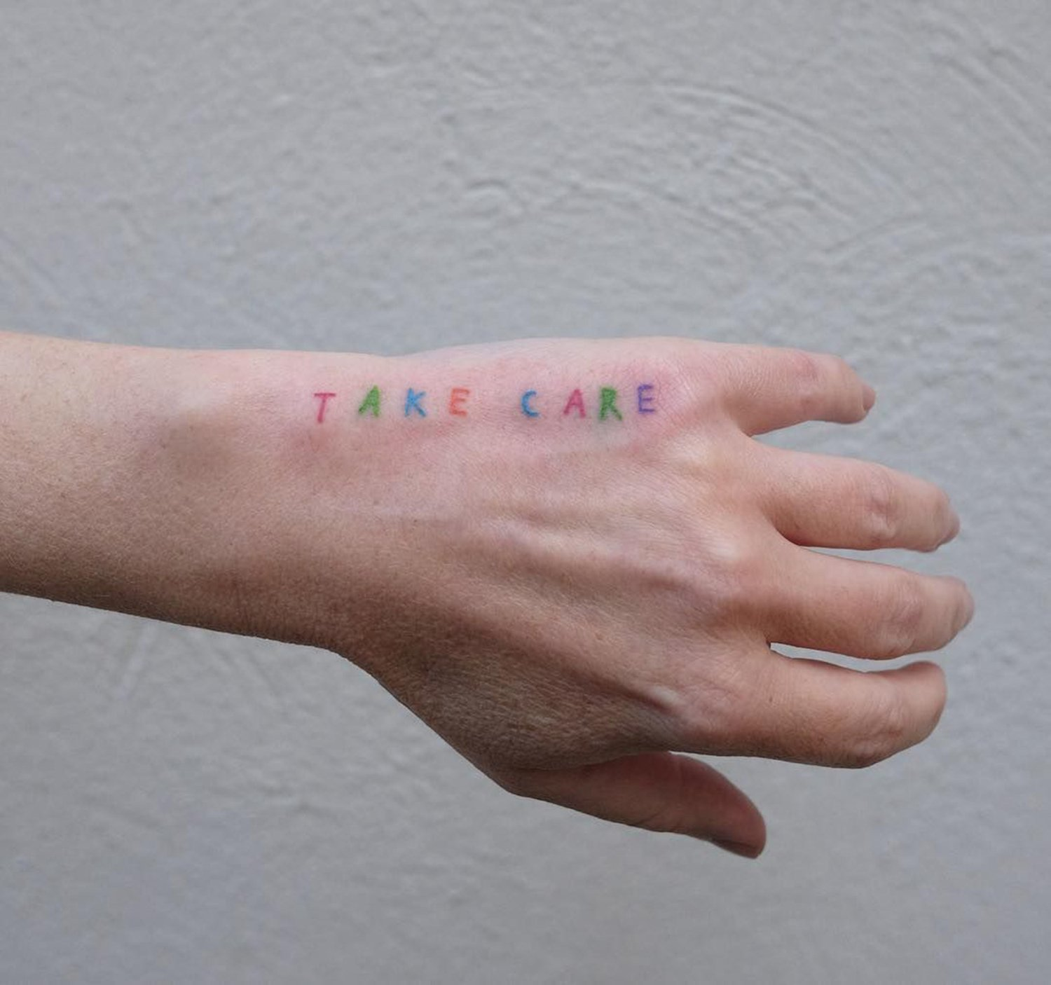 take care, type tattoo on hand