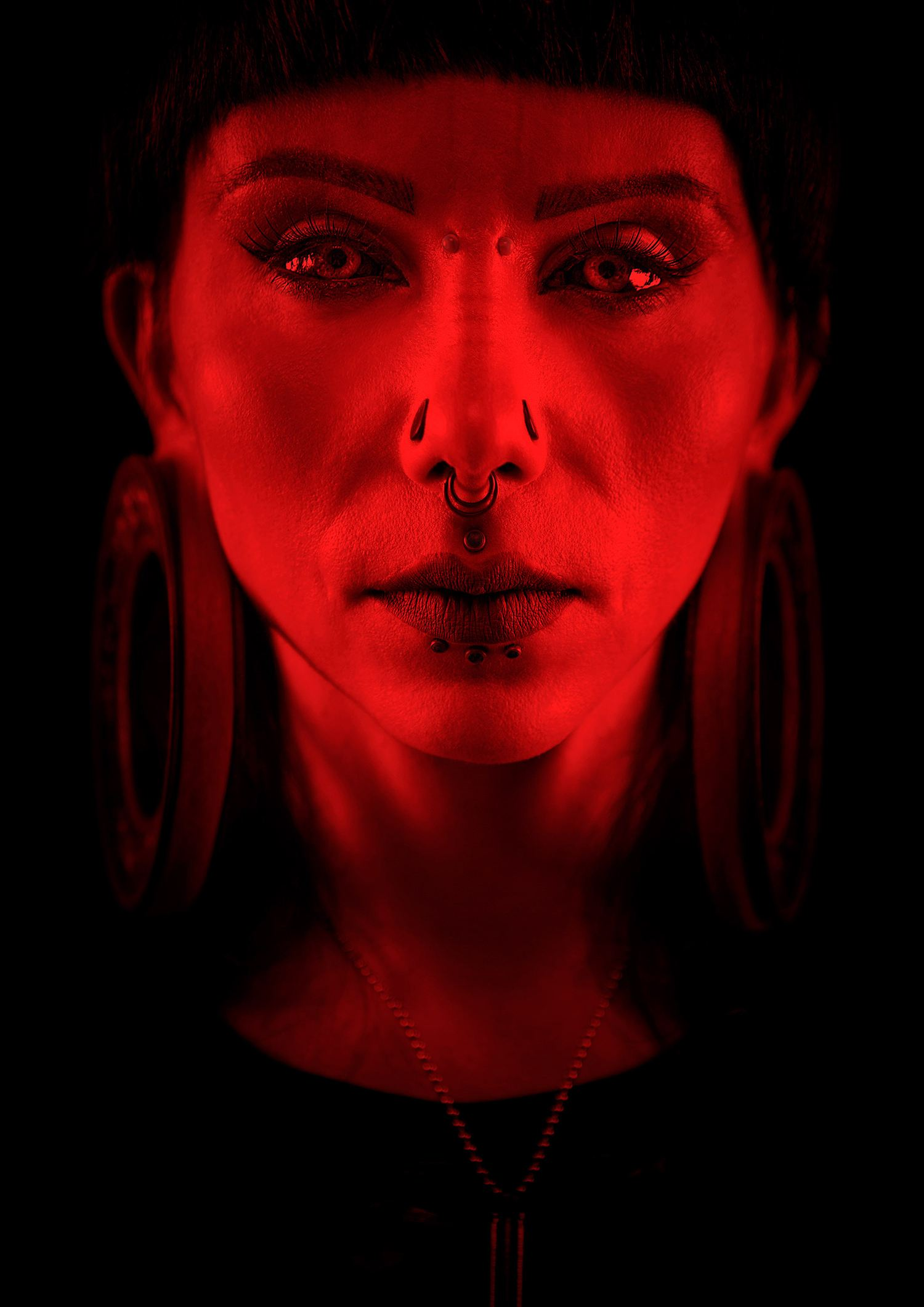veronica blades in red lighting, photography