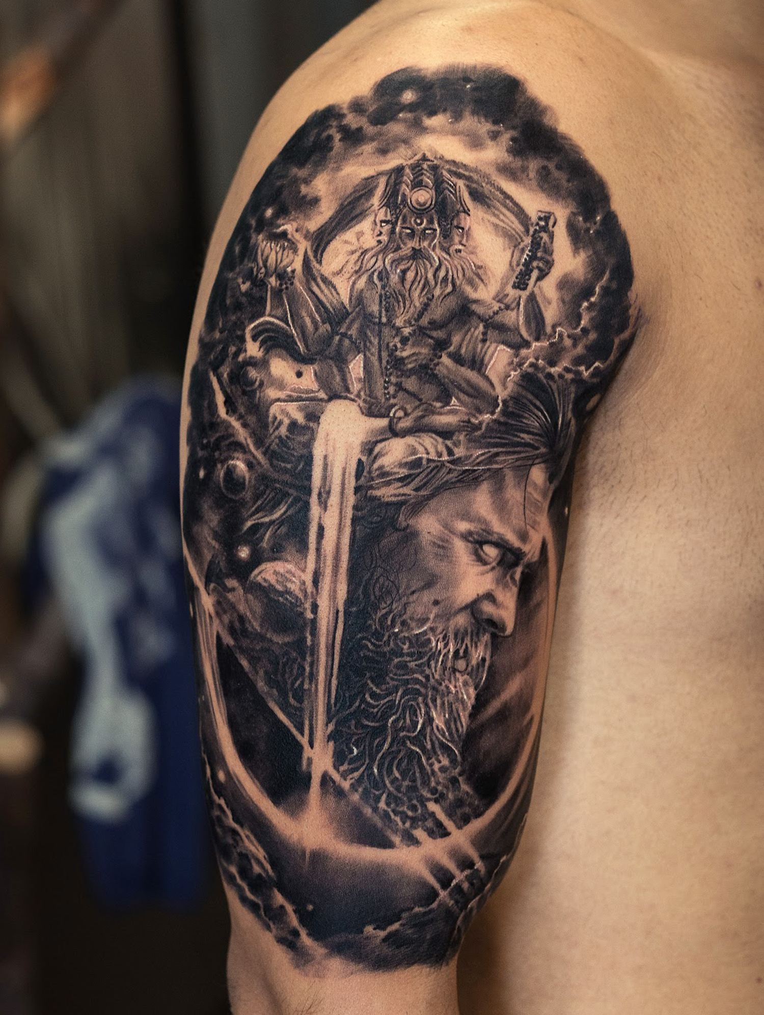 black and grey spiritual tattoo by Sunny Bhanushali