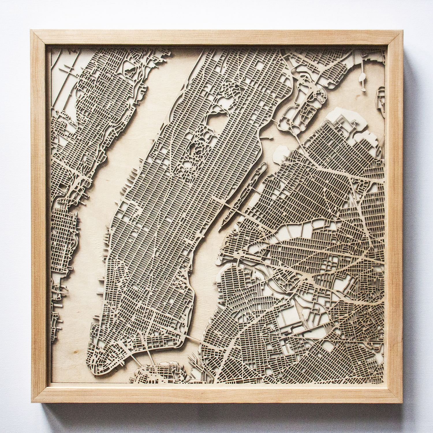 "Hubert Roguski's ""CityWood"" uses plywood and laser technology to recreate Manhattan's cityscape."