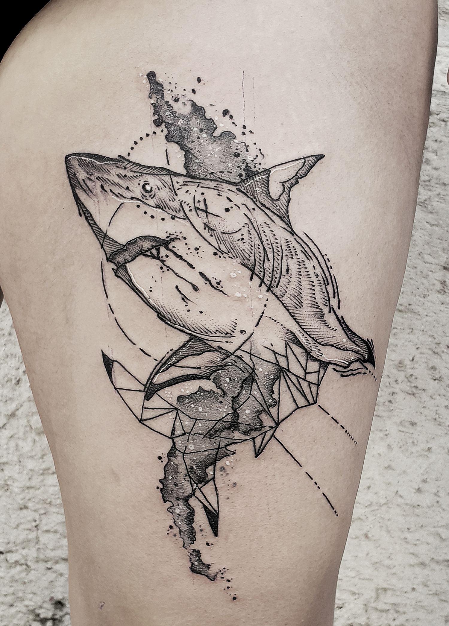 illustrative blackwork tattoo of shark