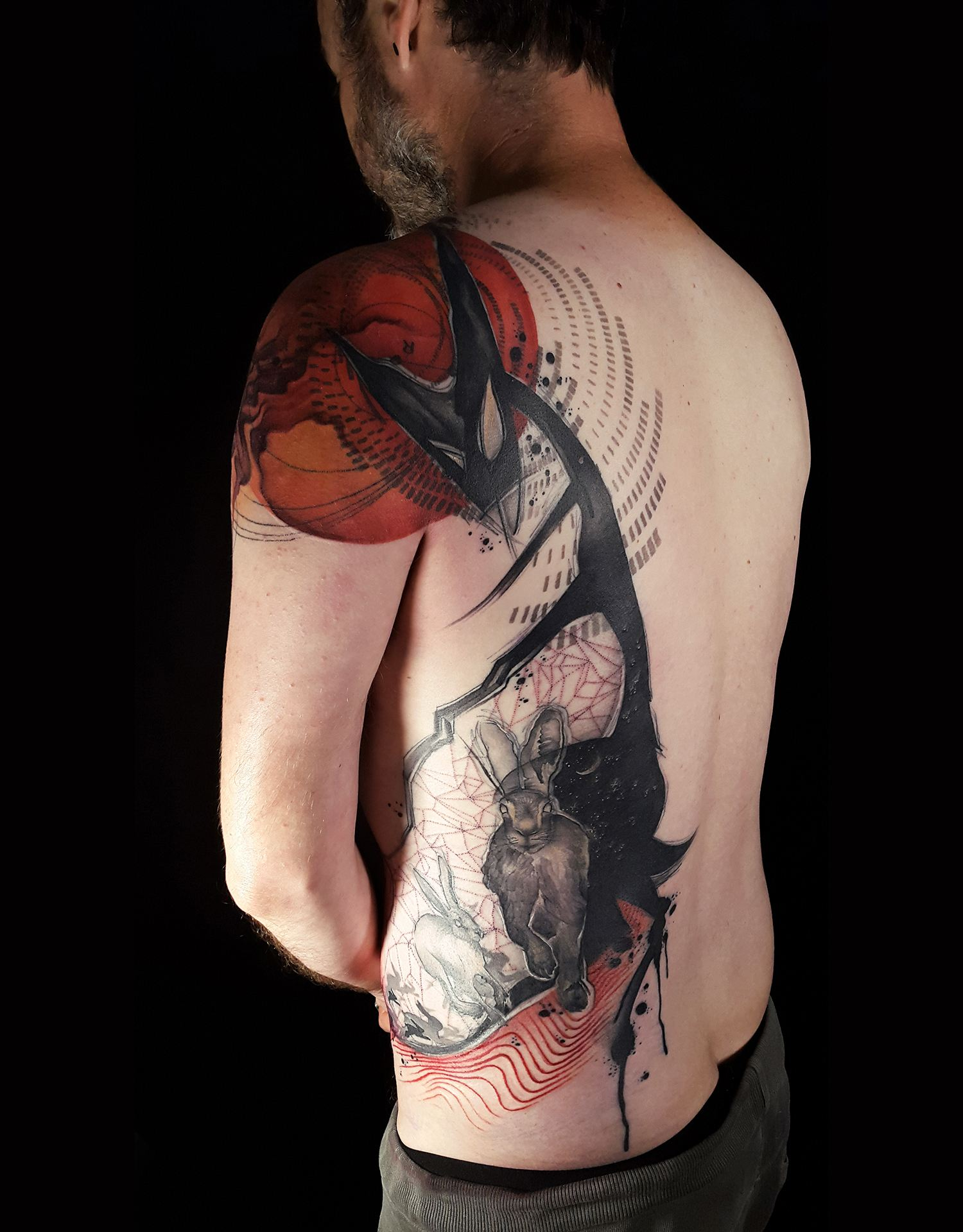 back and shoulder tattoo, red and black ink, tattoo