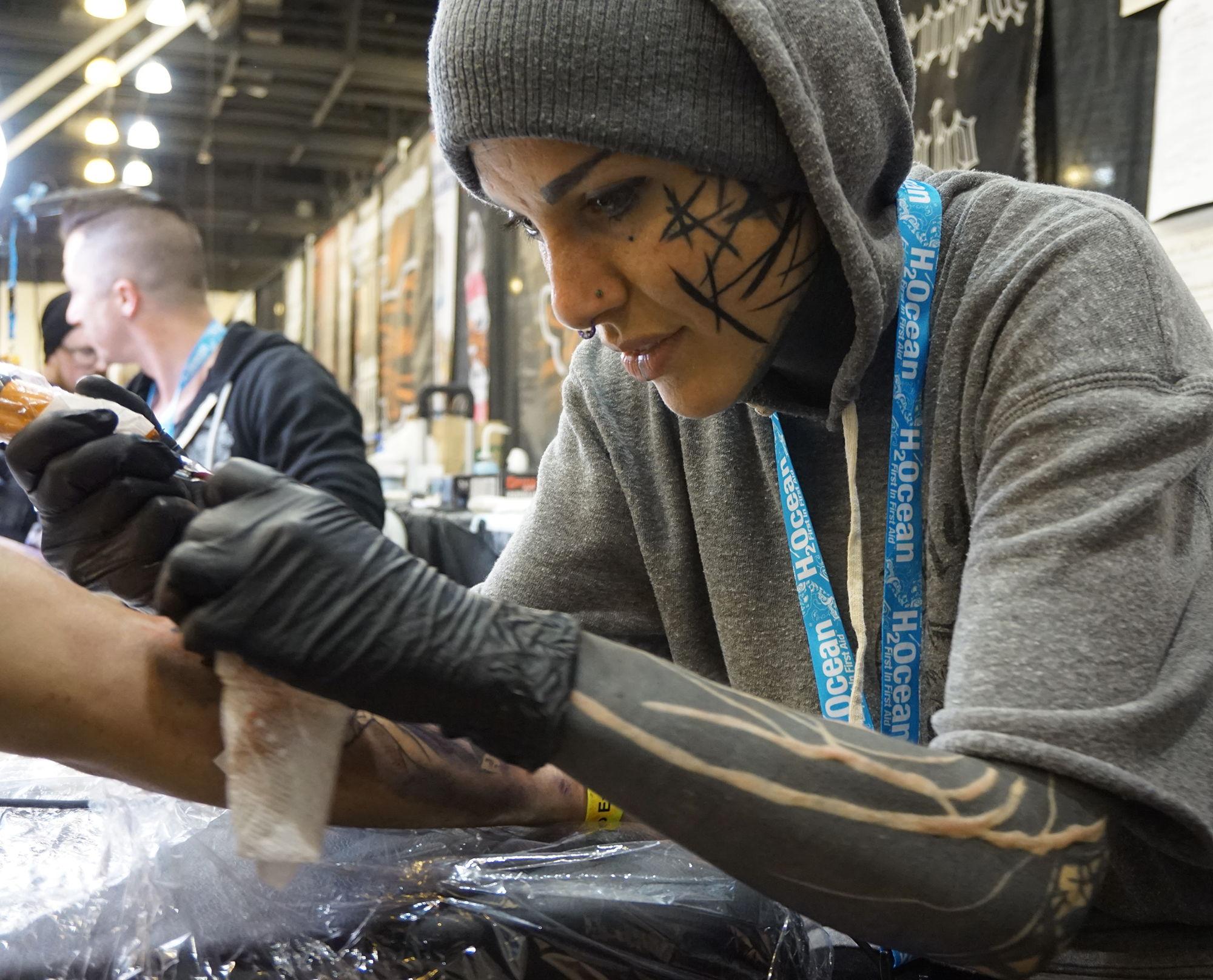 tattooer michela bottin at the golden state tattoo expo, california