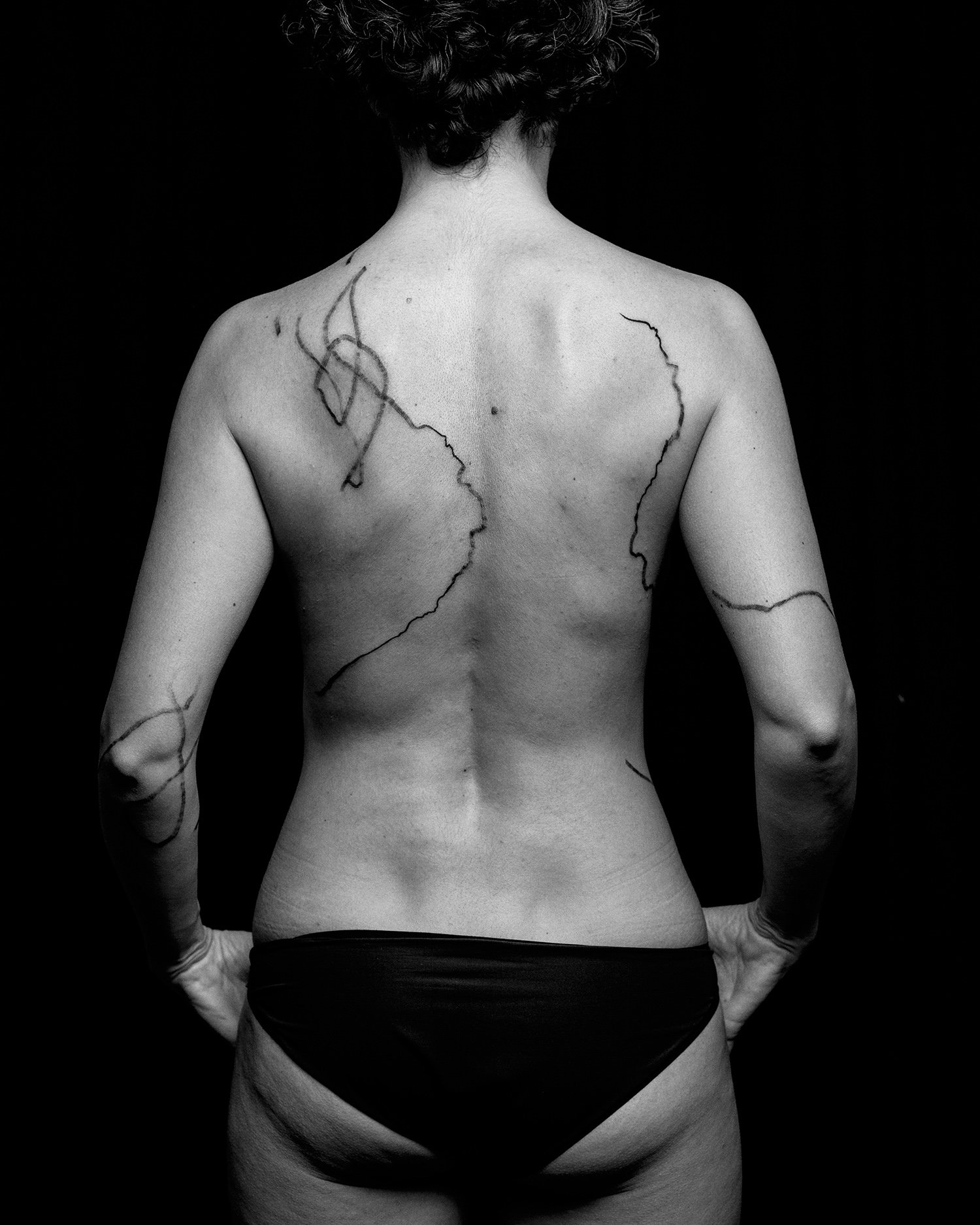 Marcela's back, flow of lines, abstract tattoos, black ink