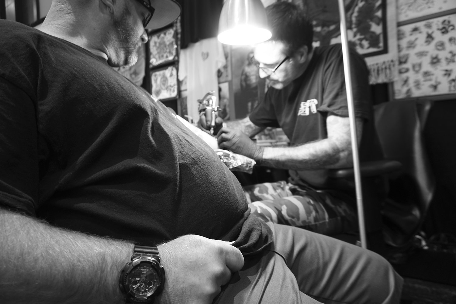 Tim Hendricks (miami ink) tattooing client at event