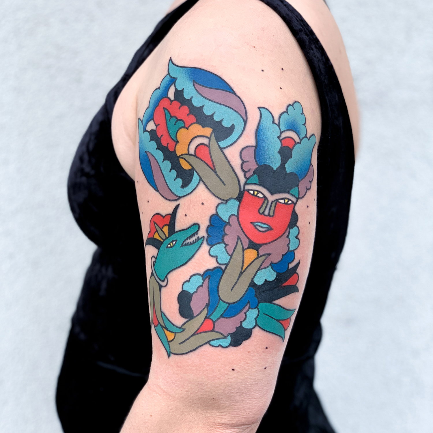 lips, mouth and flowers, abstract color tattoo on arm