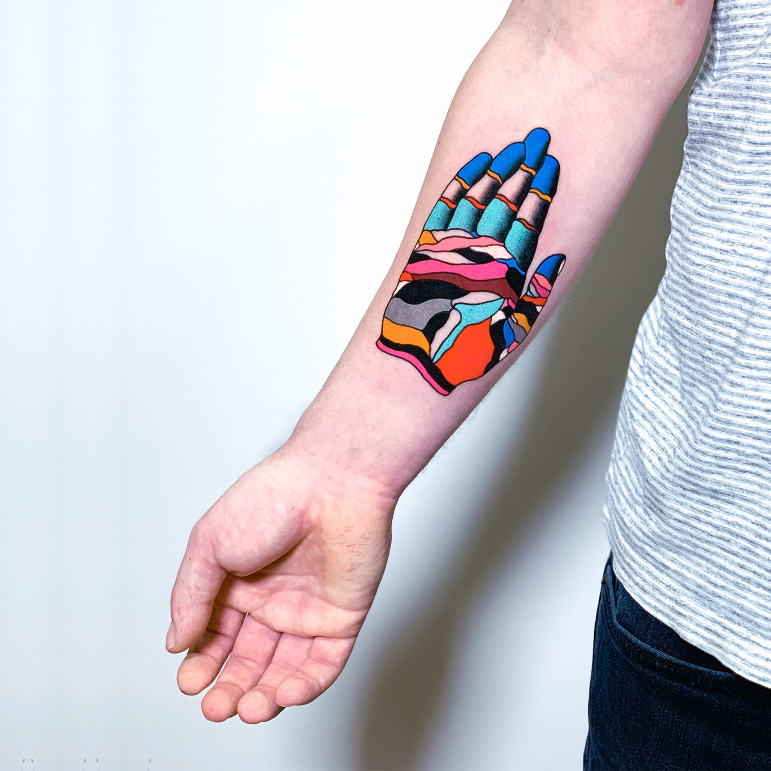 color hand tattoo on arm