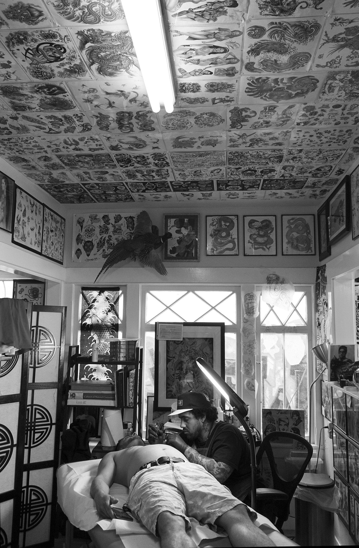 tattooist Warren (80sixer) tattooing at santarosatattoo