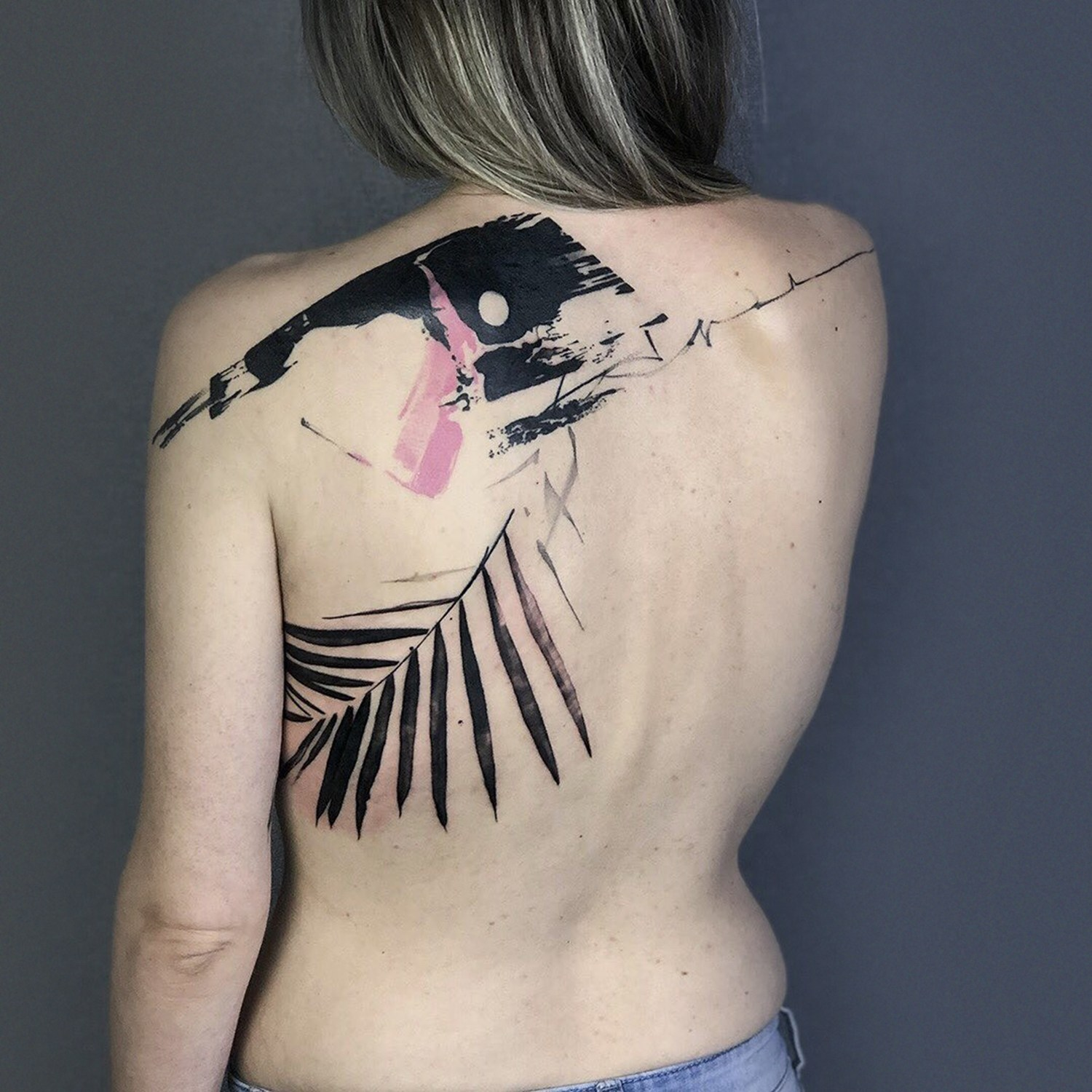 abstract cover up tattoo on back