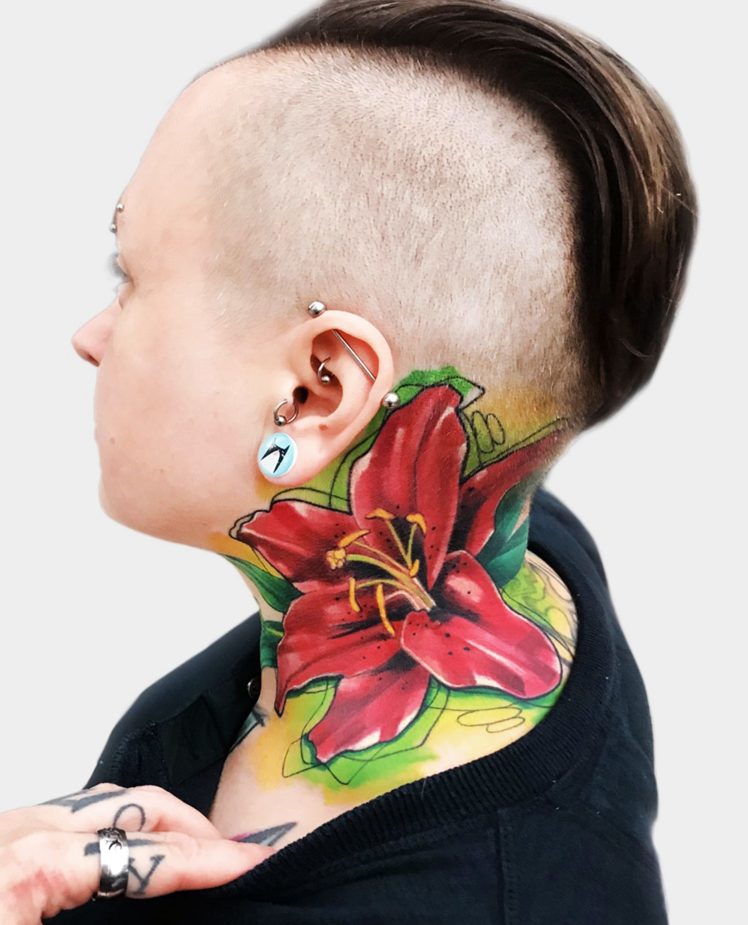 flower on neck, tattoo by ivana