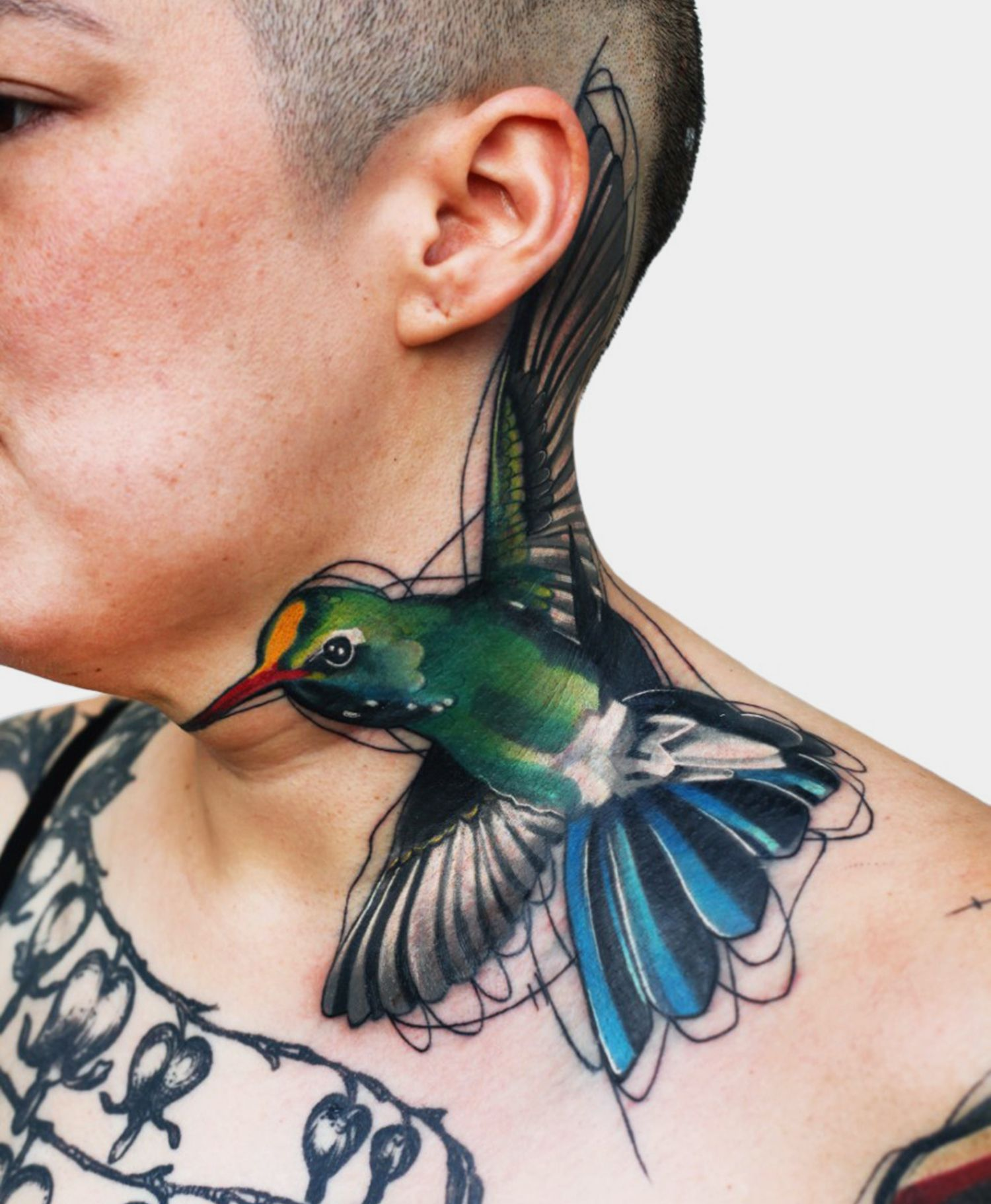 hummingbird tattoo on neck