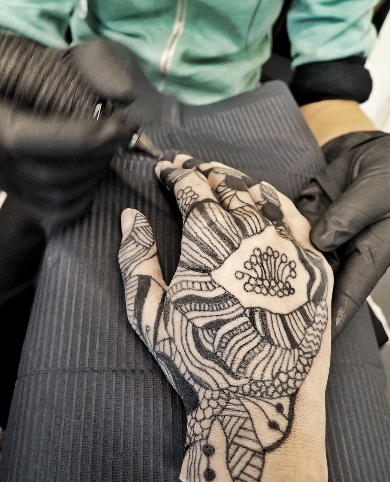 tattooing on silicone hand, blackwork