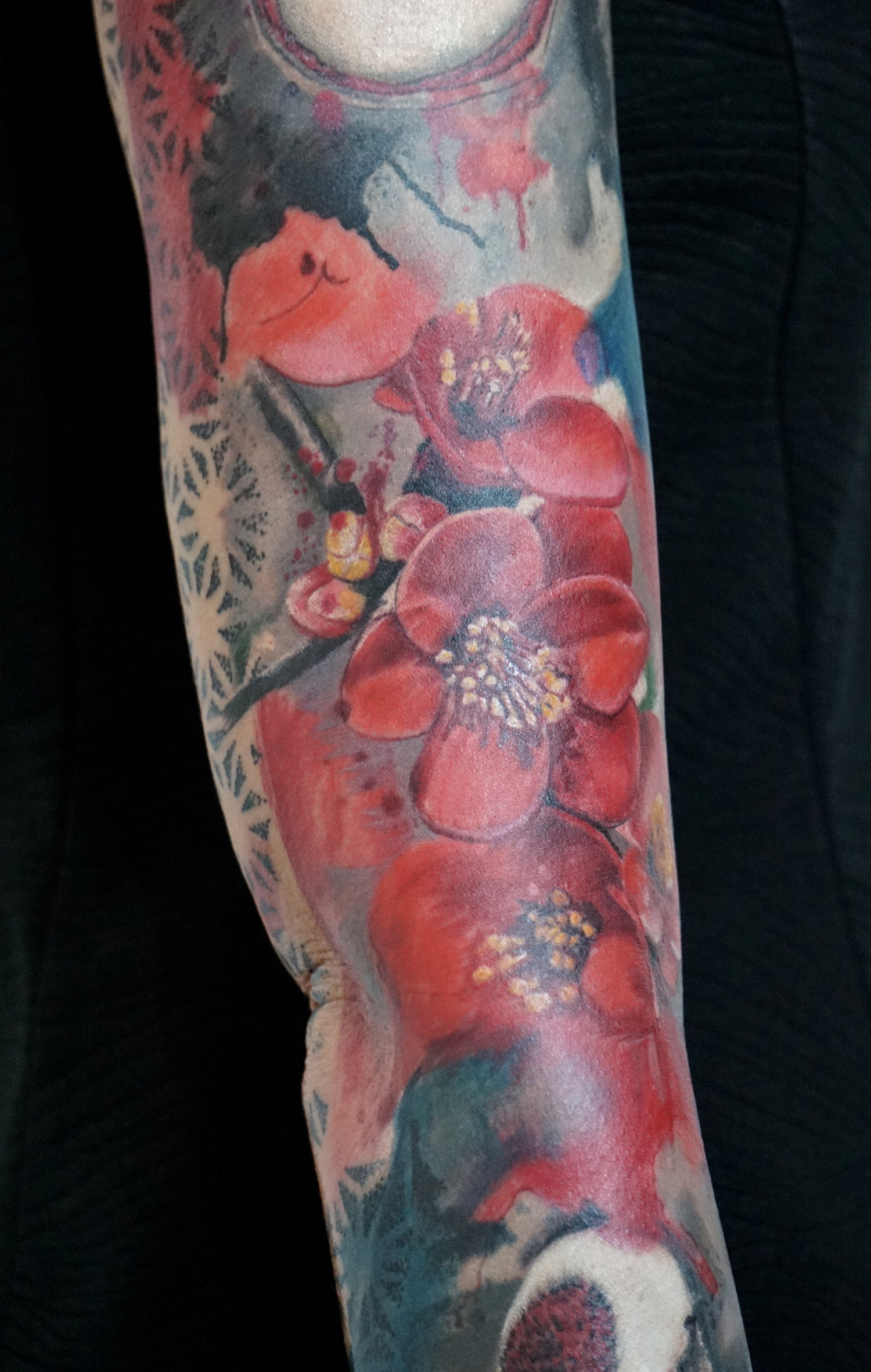 A glimpse at the elaborate Asian-style tattoo by Andy Kemp.