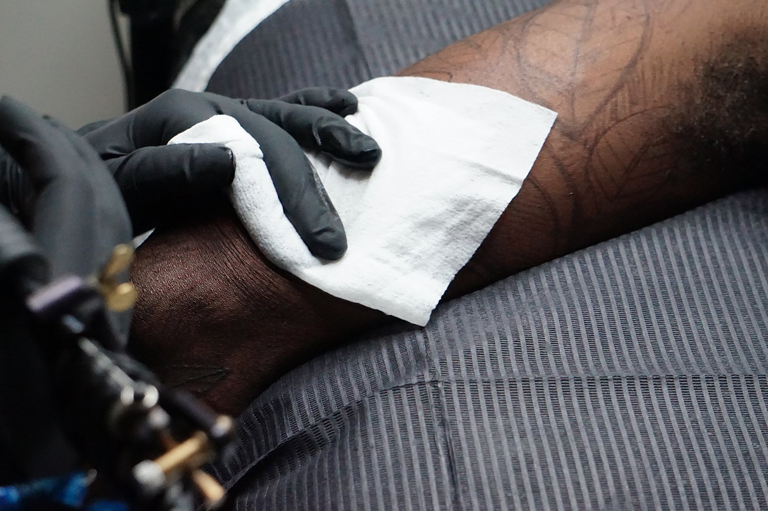 close up of blackwork tattoo on arm by yanina viland, on dark-skin