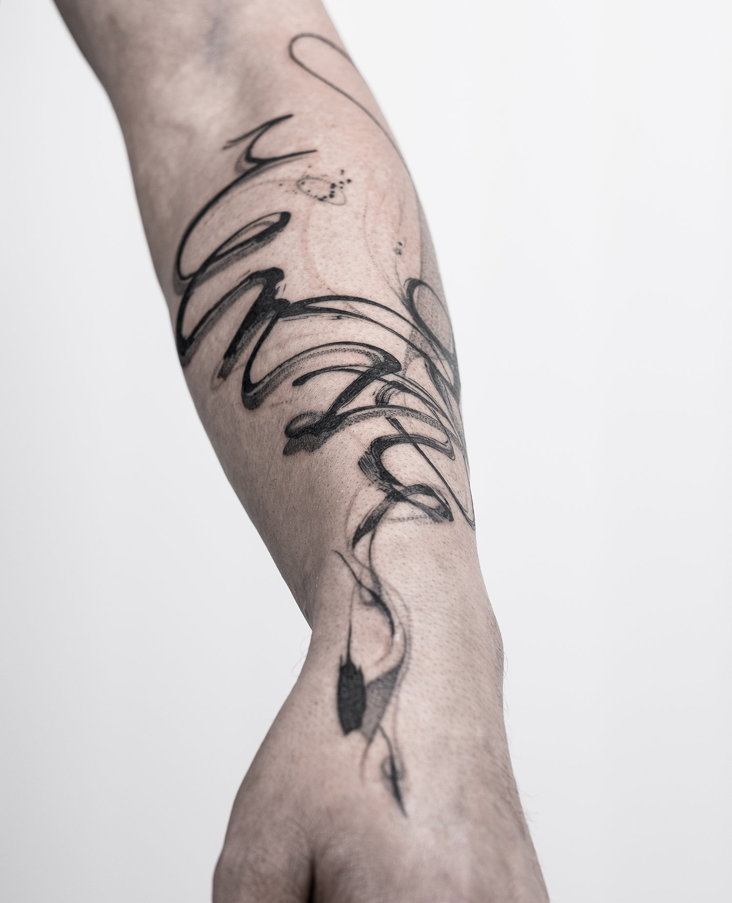 arm and hand tattoo, wavy lines, blackwork