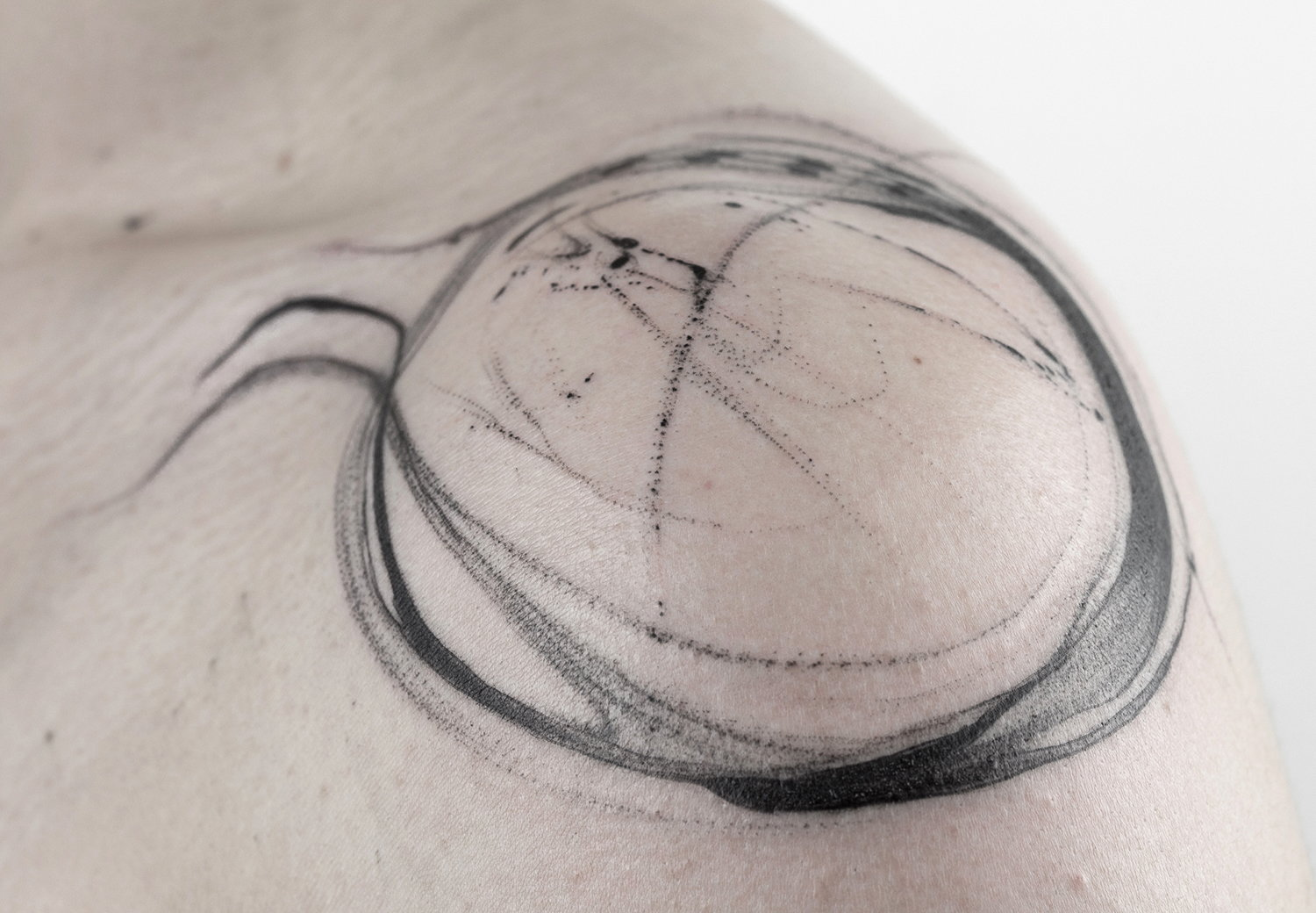 circle tattoo on shoulder, abstract