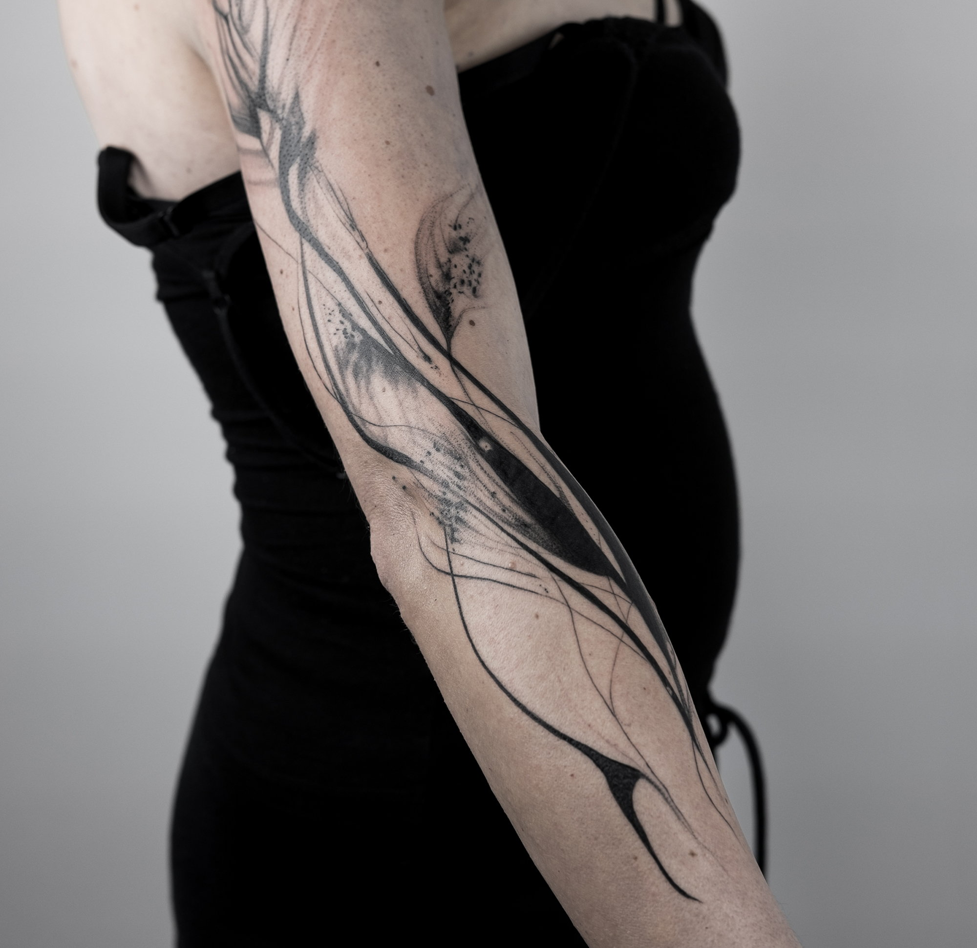 abstract, avant-garde tattoo on sleeve
