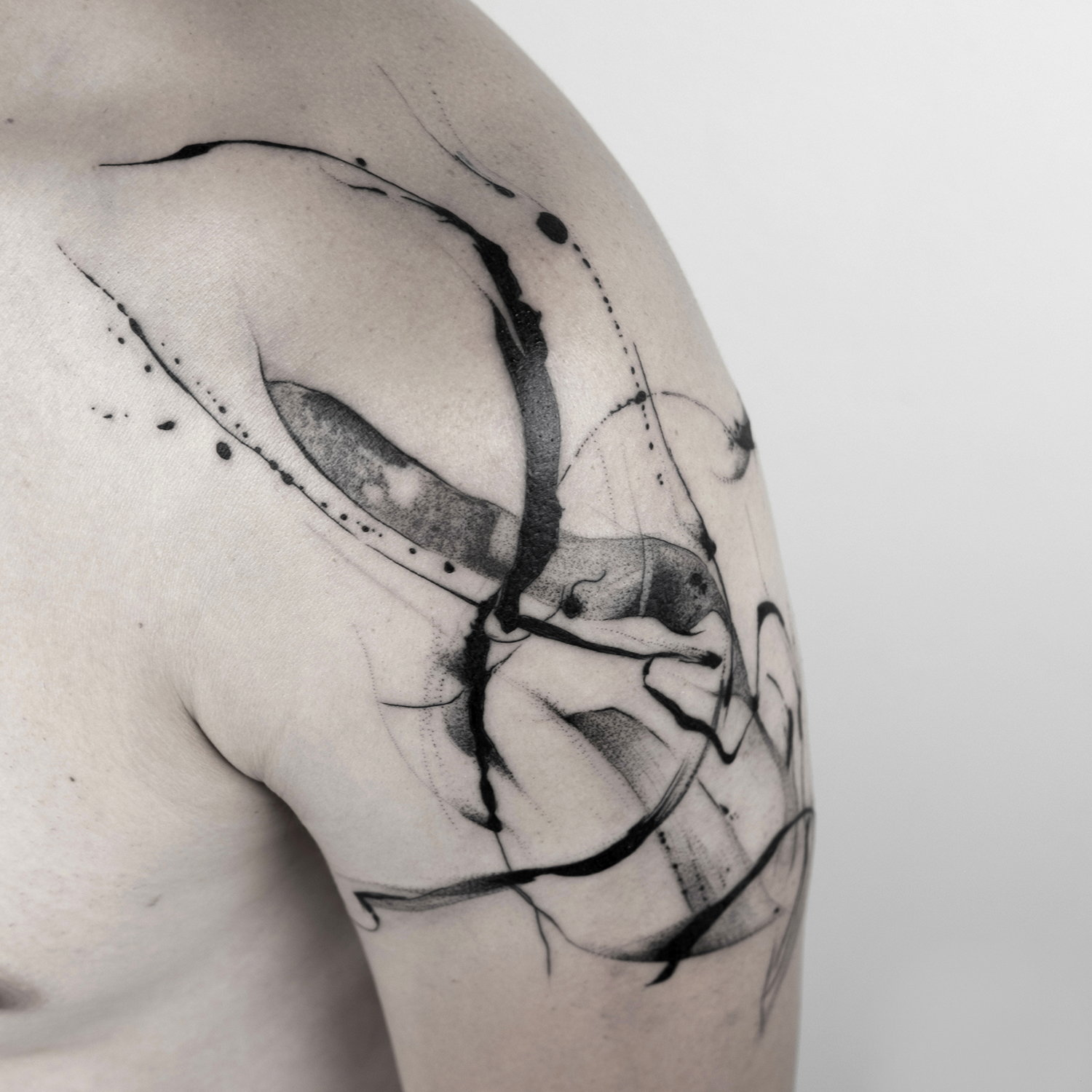 shoulder tattoo, blackwork, freehand, flow and motion, poetic