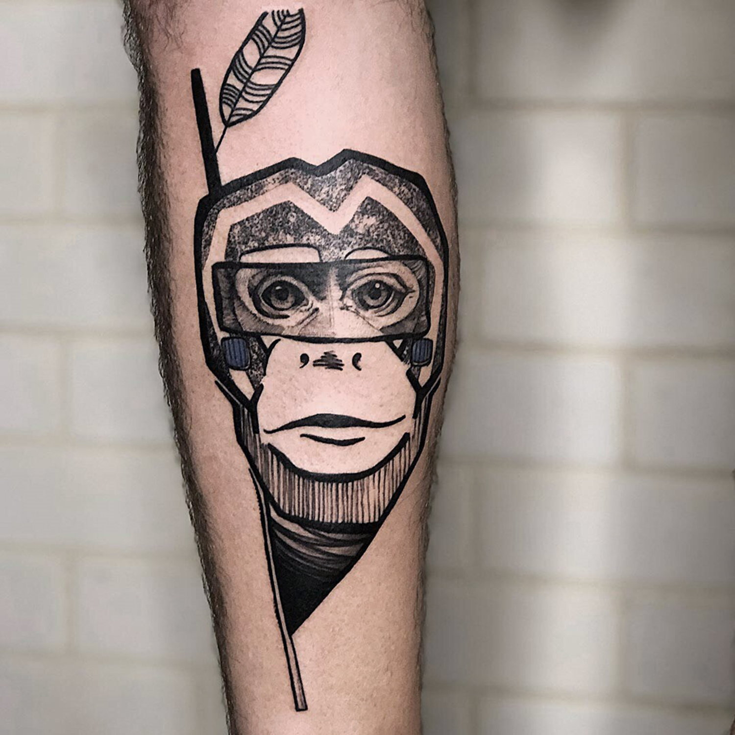 monkey tattoo on leg by shiran, tel aviv