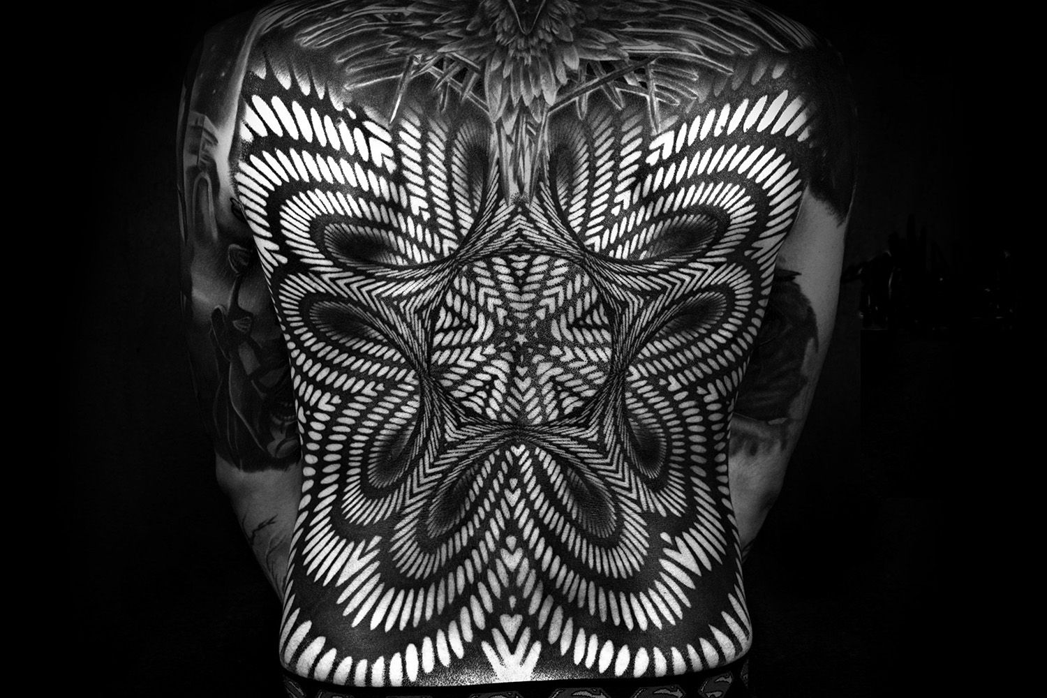 optical illusion back tattoo, blackwork, ornamental body art