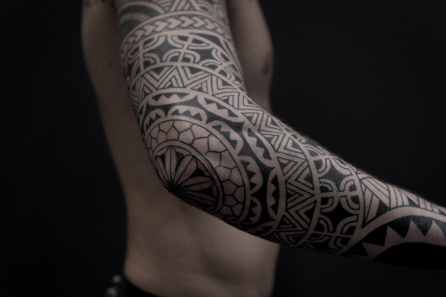 blackwork tattoo on arm, geometric shapes, neo-tribal by paradox