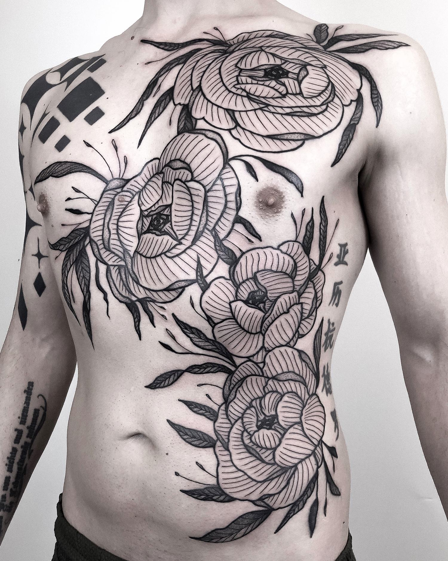 flowers on chest, botanical tattoos