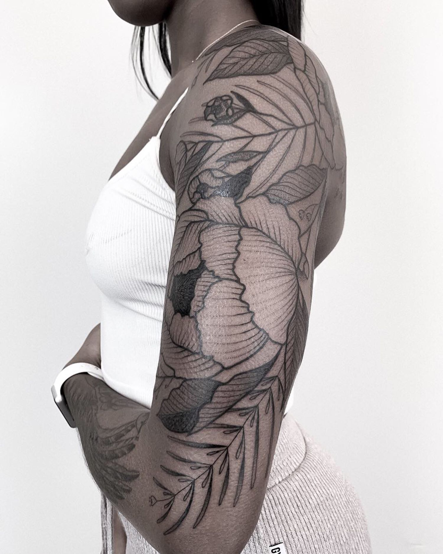 black woman, tattoo on arm, blackwork, botanical