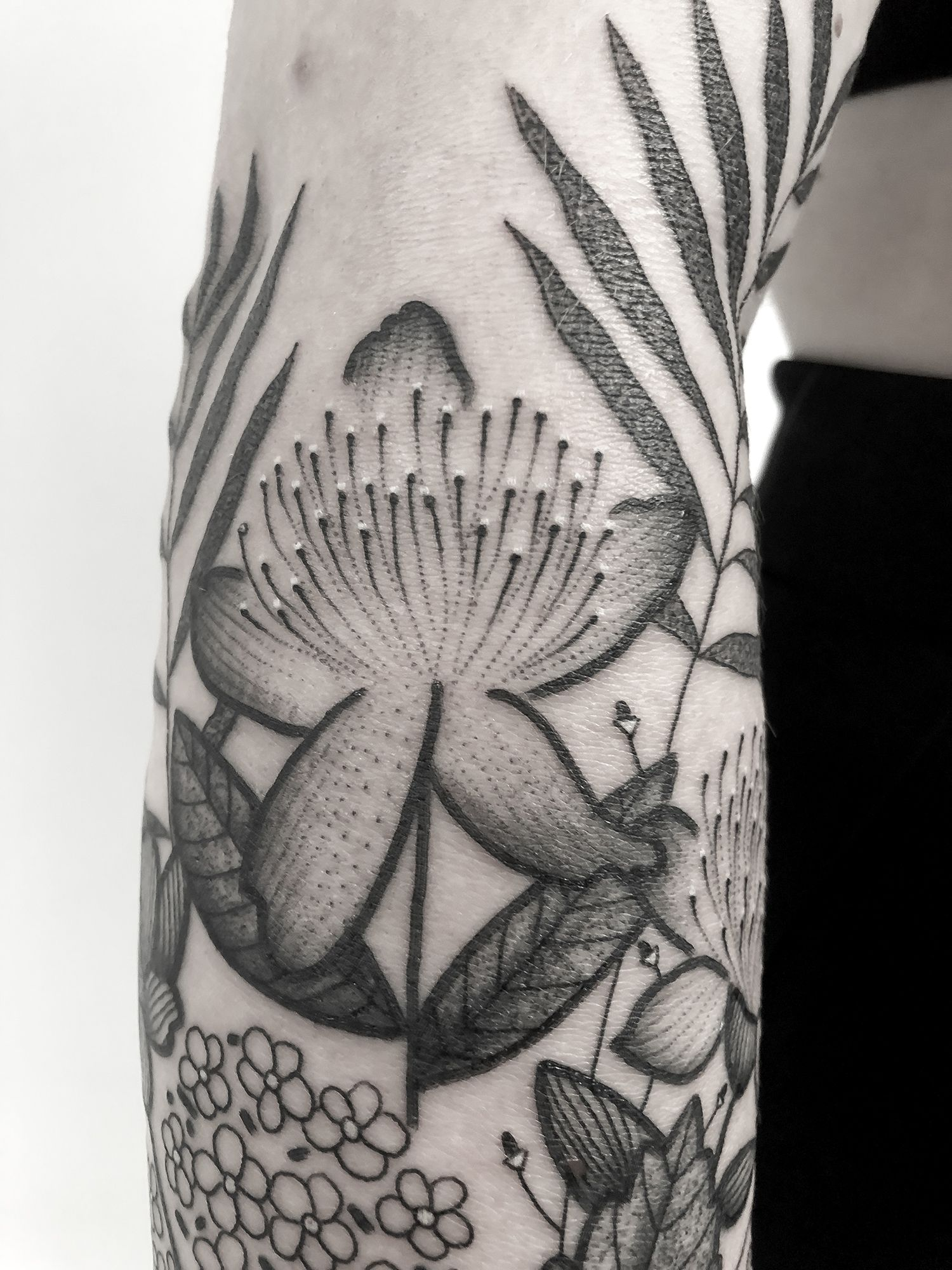 close up of tattoo, black and white ink, tattoo, flower