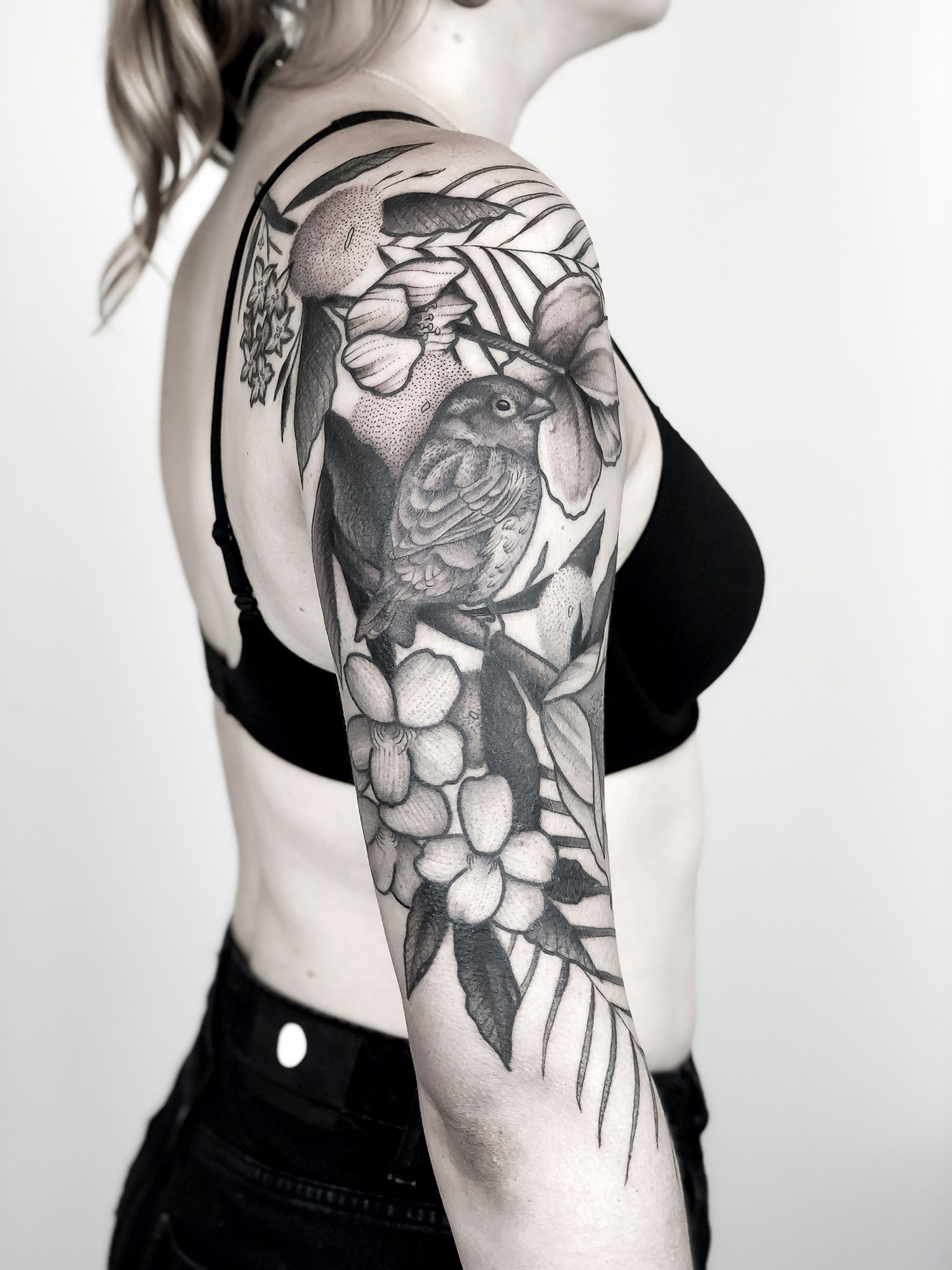 bird and flower tattoo sleeve