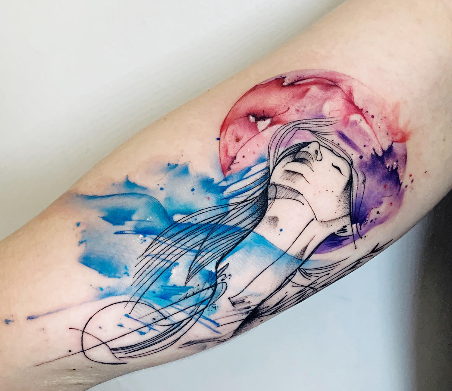 abstract face watercolor tattoo