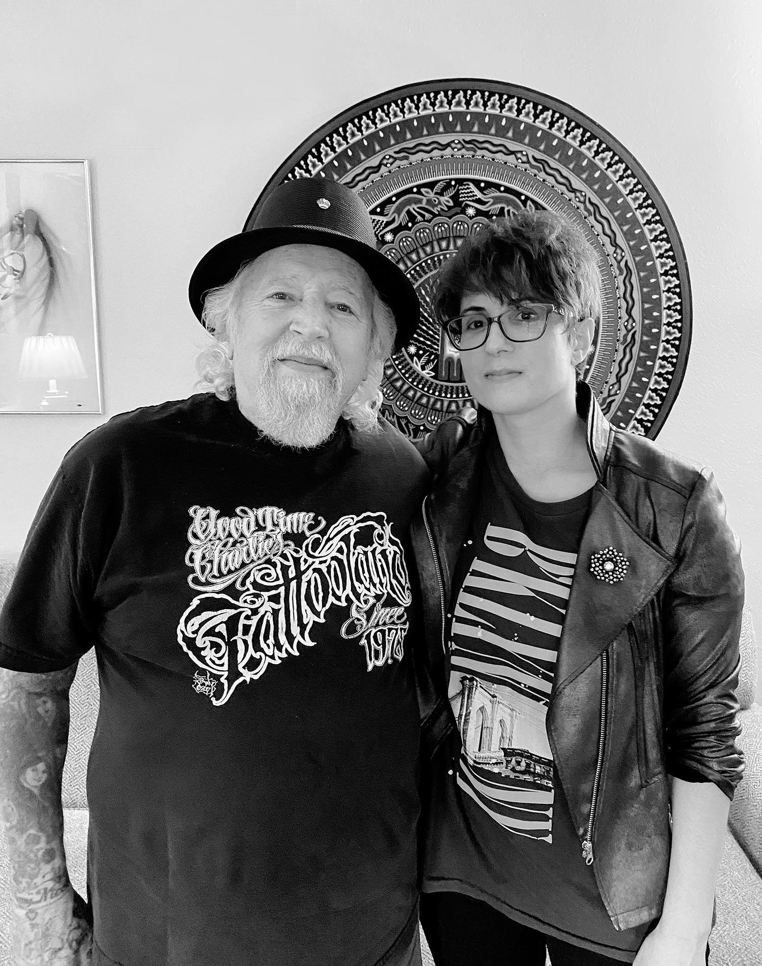 Legendary tattooer Charlie Cartwright (good time charlie) and tattoo journalist Adriana de Barros
