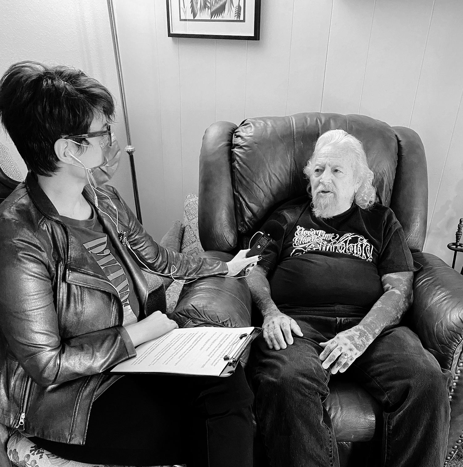 Adriana de Barros (tattoo journalist) on left, and charlie cartwright (tattoo legend black and grey prison-style) on right, interview