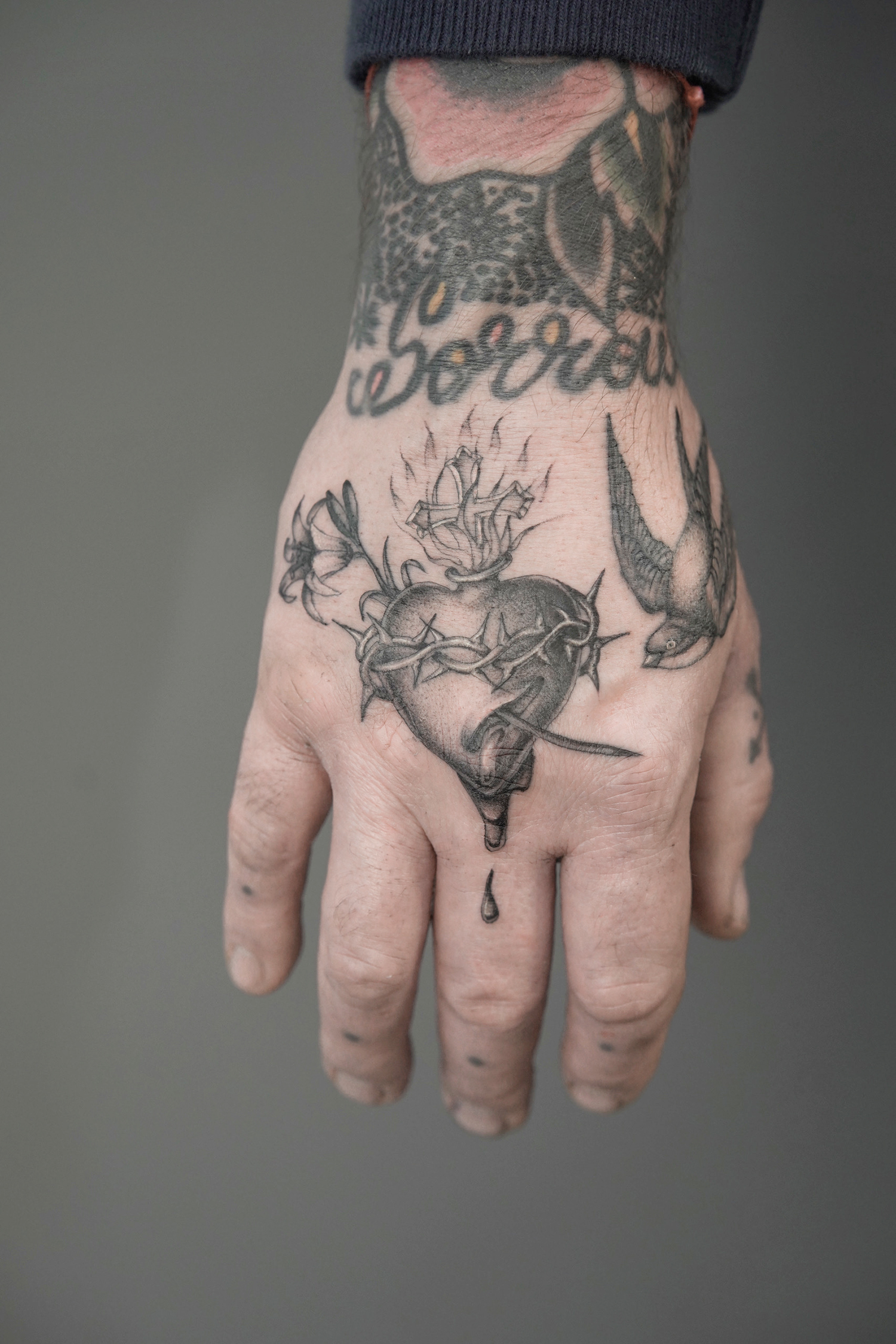 sacred heart tattoo on hand by delph musquet